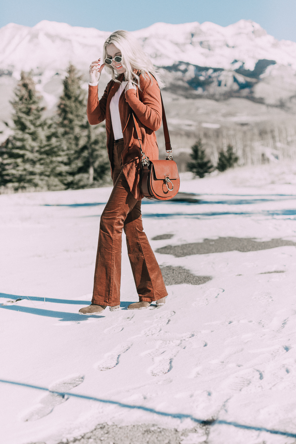 Corduroy Pants by Blank NYC paired with a Leith circle cardigan in this monochromatic rust look on fashion blogger over 40 Erin Busbee of Busbee Style in Telluride, Colorado paired with Chloe Tess Bag medium size