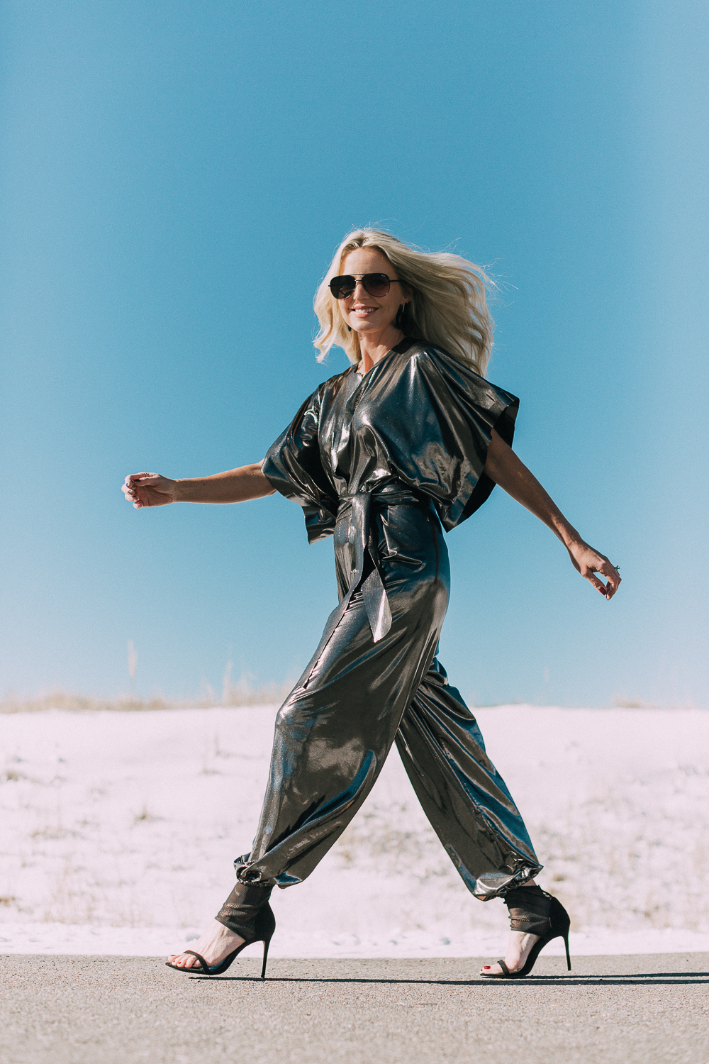 New Year's Eve Outfit Ideas featuring a metallic jumpsuit by Norma Kamali with black heels on Fashion Blogger Erin Busbee of Busbee Style, fashion over 40