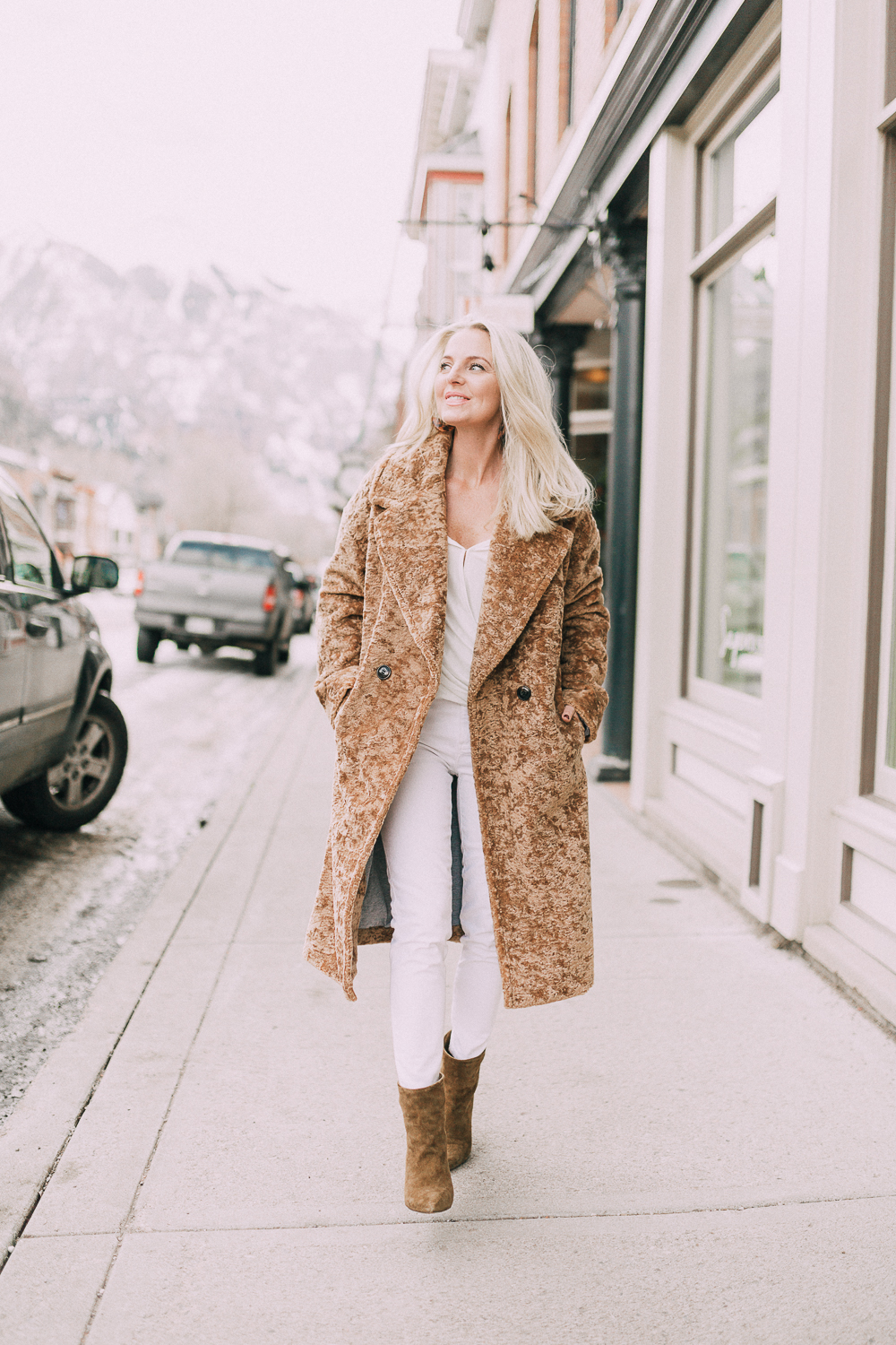 ave les filles fuzzy jacket with an all white outfit on fashion blogger busbee style
