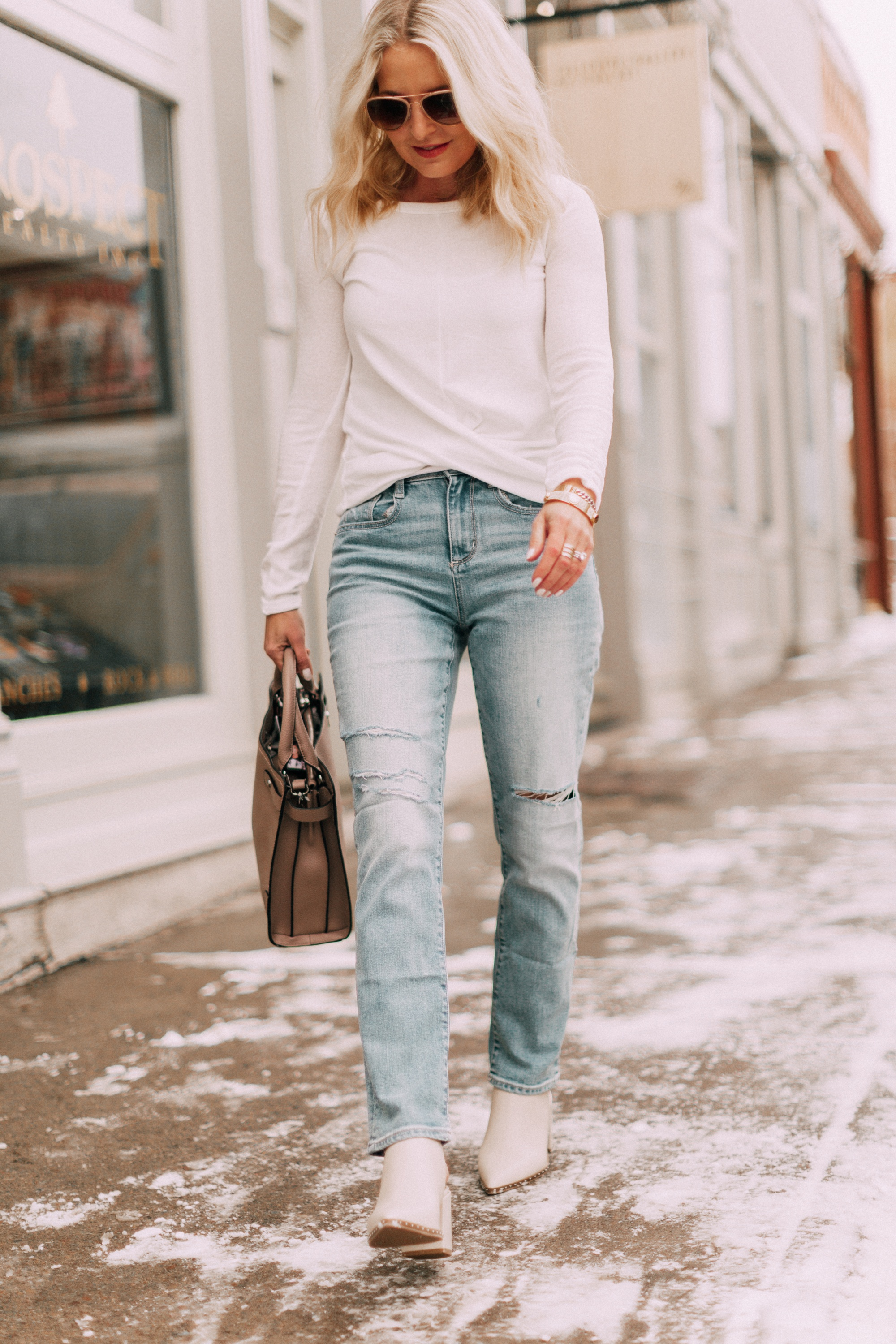 Winter Neutrals, how to wear beautiful white neutrals for winter by fashion blogger over 40, erin busbee of busbeestyle.com in this white top by By&By, light wash jeans by Brooklyn & Bailey, and off white booties by Qupid from JCPenney