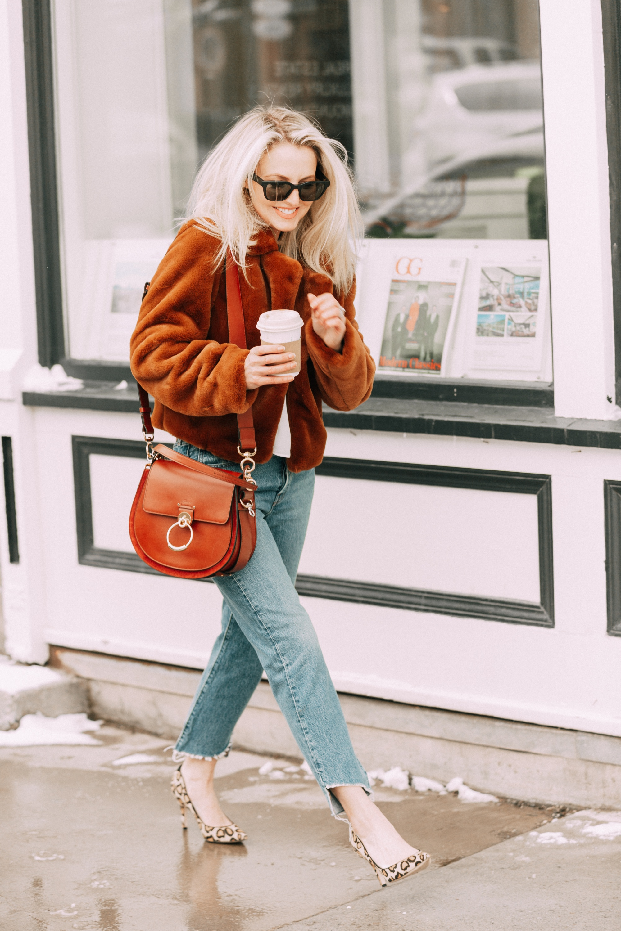 Bose Frames review by lifestyle blogger Erin Busbee, BusbeeStyle.com, wearing the Alto frames in black with a brown faux fur jacket by BlankNYC and carrying a sepia Chloe Tess Bag