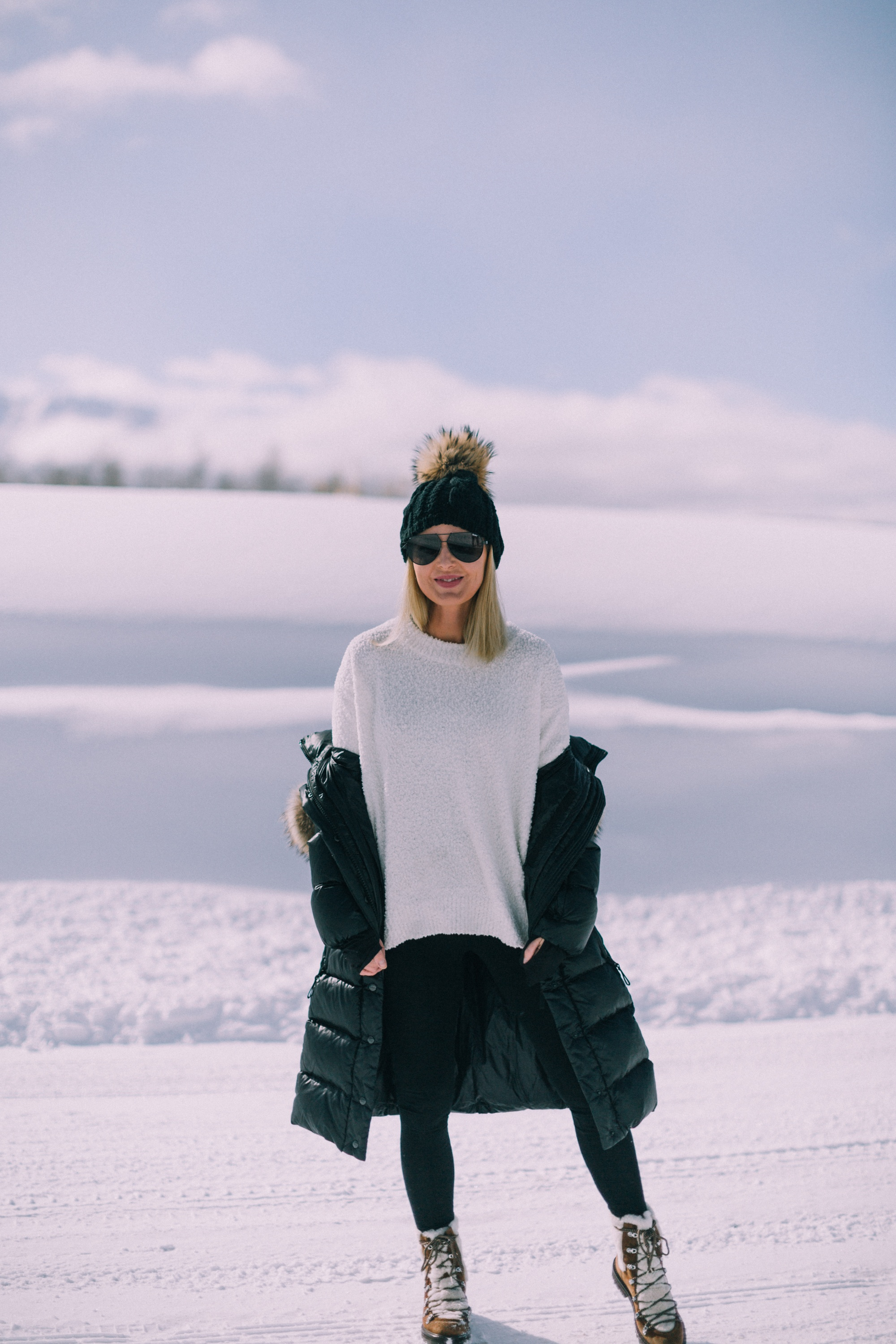fashion blogger over 40 showing you can wear Spanx seamless leggings as pants with Sanctuary sweater in telluride Colorado