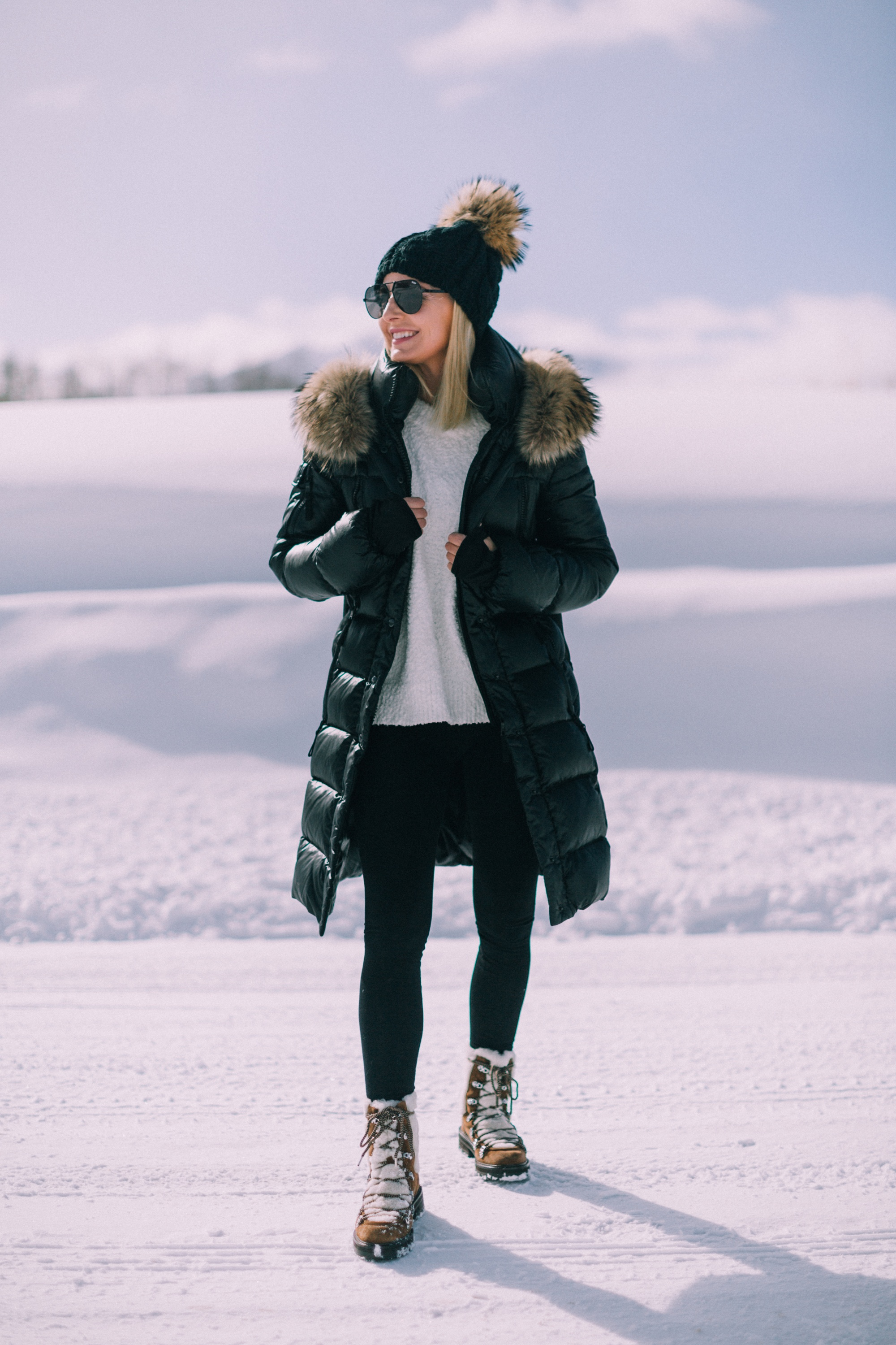 fashion blogger over 40 years old showing how to wear Spanx leggings with SAM puffer coat Sanctuary sweater sigerson morrison isla fur boots in Telluride Colorado