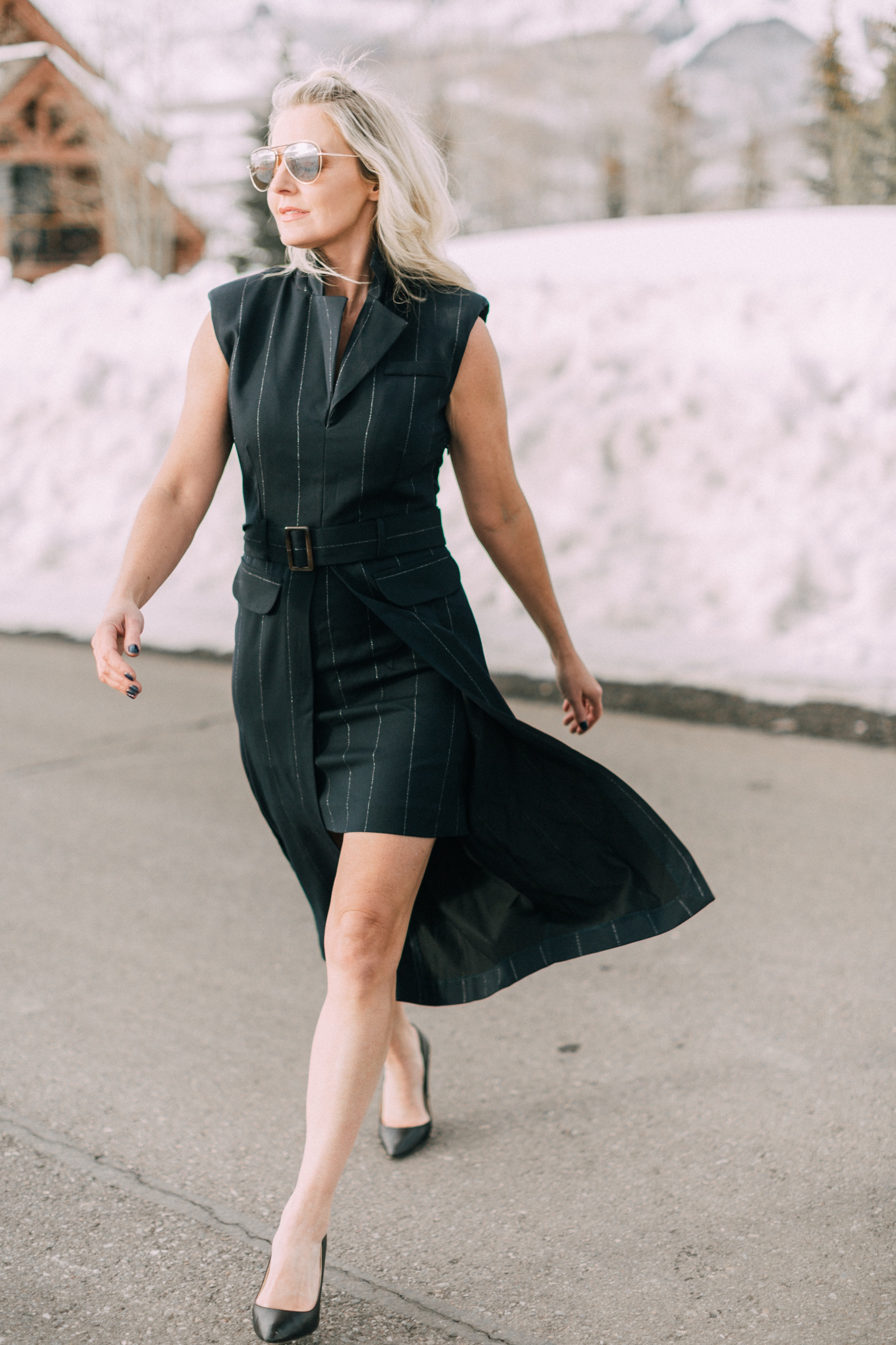Spring Office Dress, fashion blogger Erin Busbee of BusbeeStyle.com wearing a navy pinstripe dress from Asos with black Jimmy Choo pumps in Telluride, Colorado, talking about dresses for the office