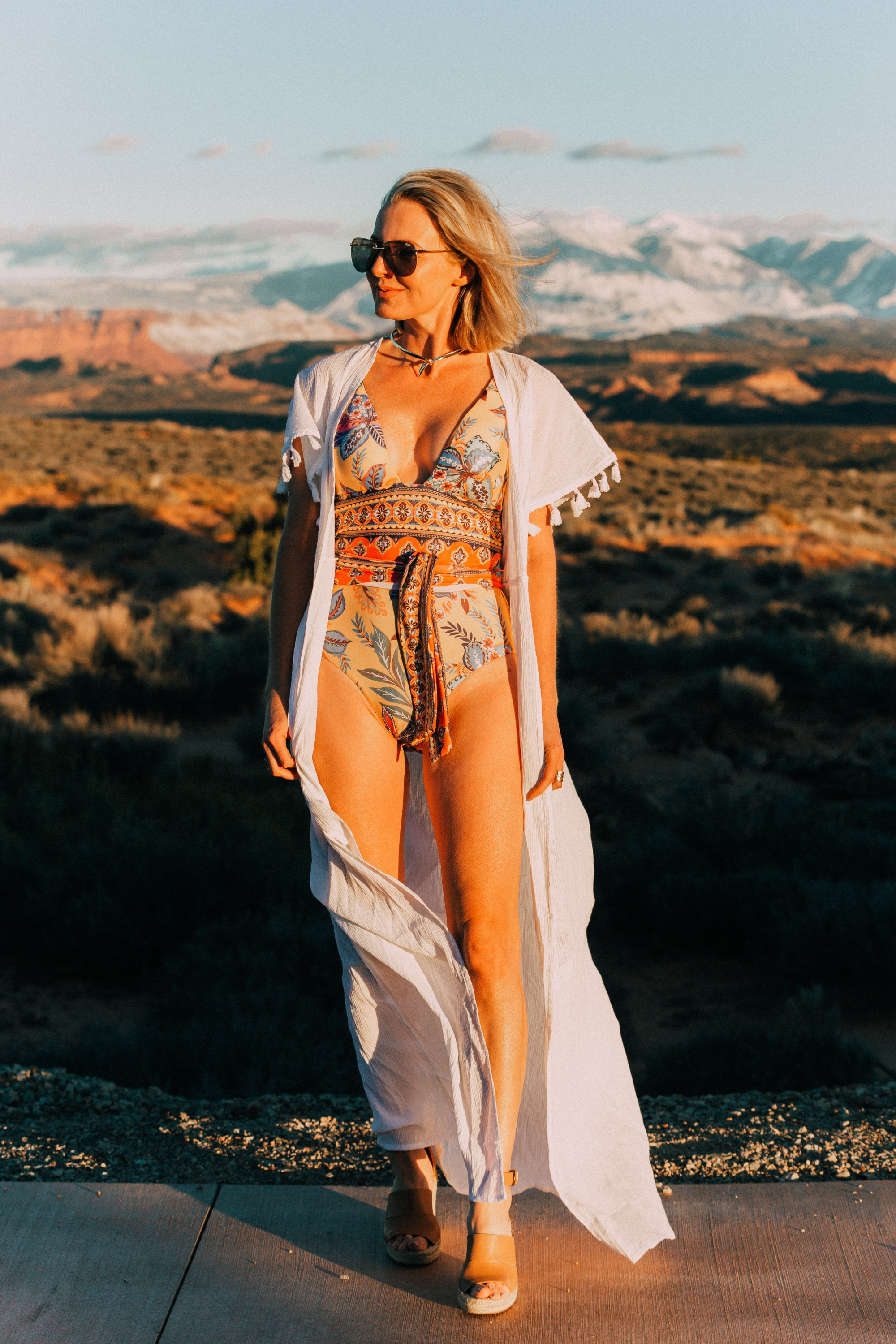 Full Coverage one piece paisley swimsuit by becca for women over 40 years old with Eddie Bargo choker necklace, Treasure & Bond espadrille sandals, and a white tassel kimono from Asos in Moab, Utah