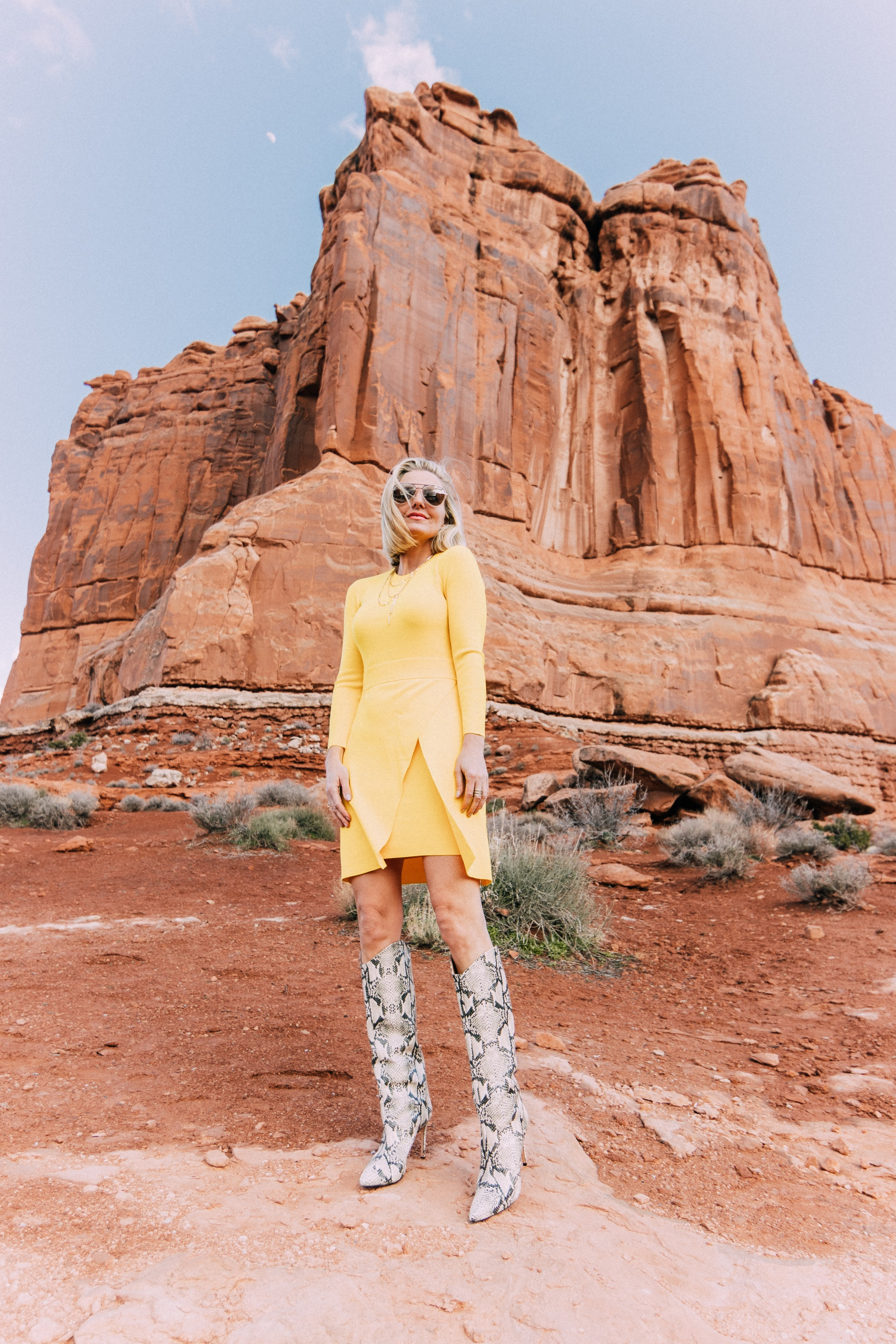 What To Wear To A Spring Wedding, Fashion blogger Erin Busbee of BusbeeStyle.com wearing a yellow long sleeve mini dress by ALC and Schultz python print boots in Moab, Utah
