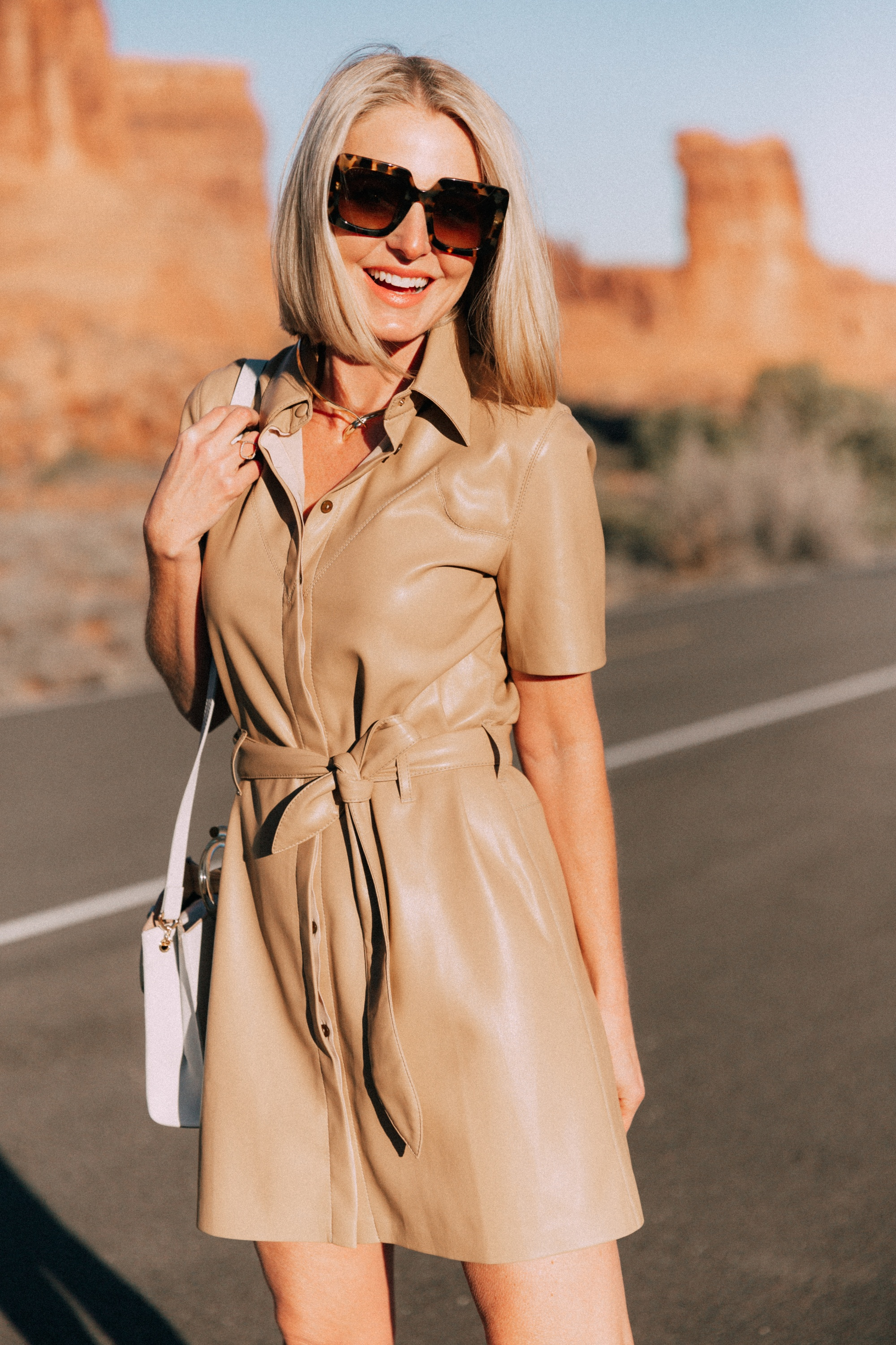 Spring Dresses, Fashion blogger Erin Busbee of BusbeeStyle.com wearing a chic tan leather dress with Dolce Vita python heels and a Lizzie Fortunato bag in Moab, Utah