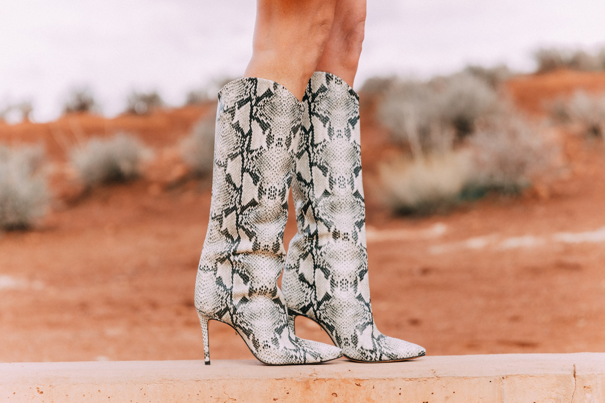 What To Wear To A Spring Wedding, Fashion blogger Erin Busbee of BusbeeStyle.com Schultz python print boots in Moab, Utah