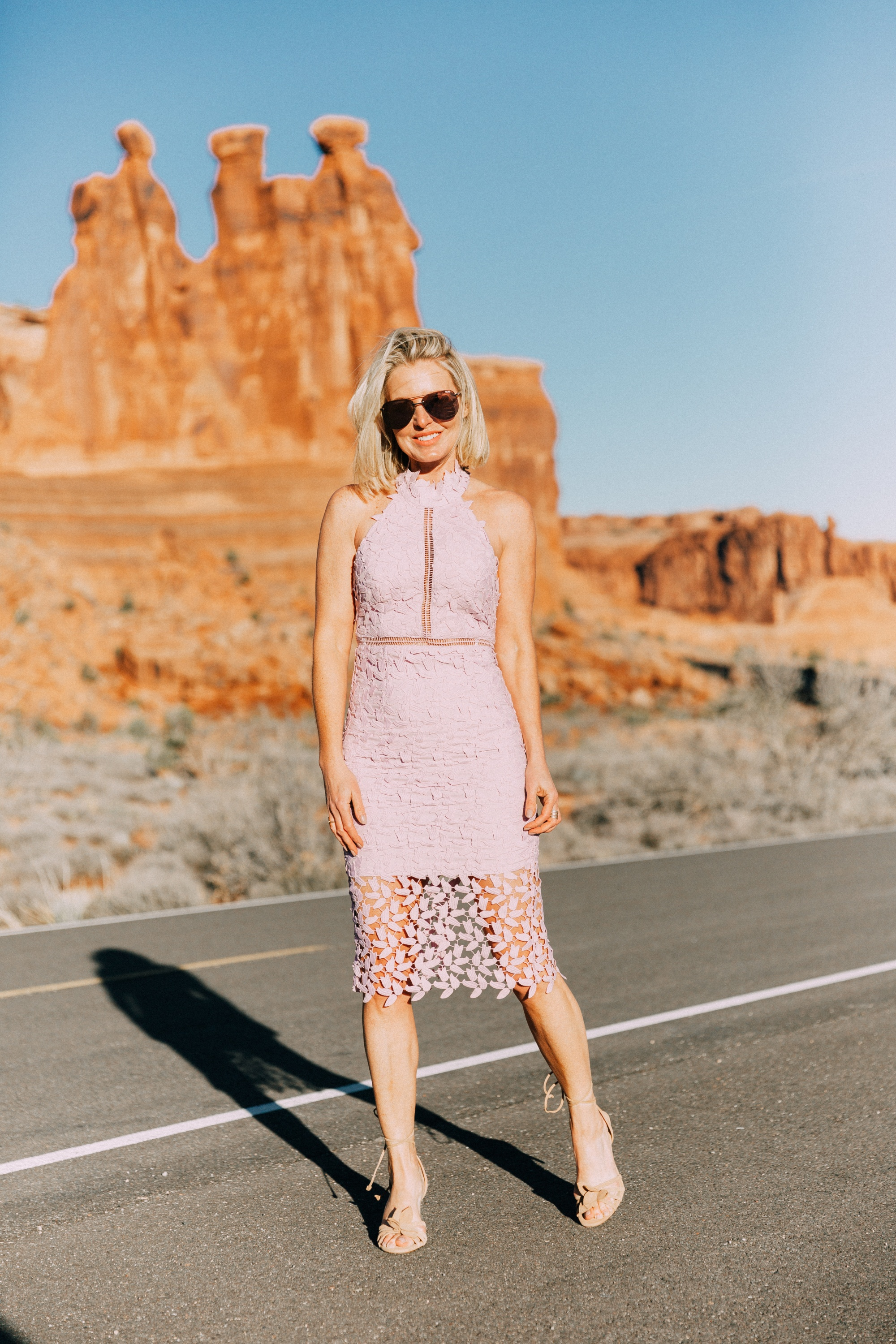 What To Wear To A Spring Wedding, Fashion blogger Erin Busbee of BusbeeStyle.com wearing a lavender lace Bardot dress from Nordstrom with strappy heels from Ann Taylor in Moab, Utah