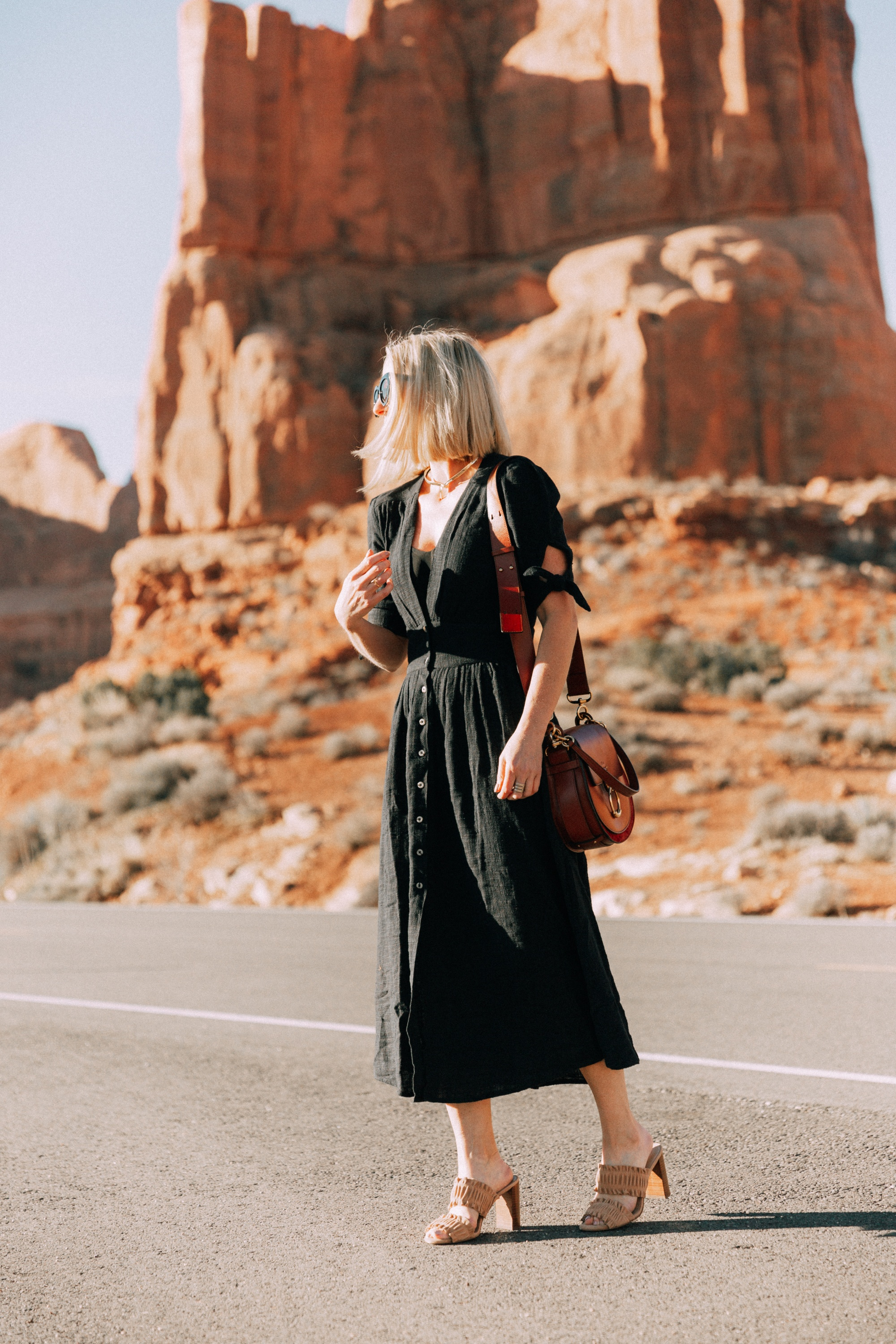 Spring Dresses, Fashion blogger Erin Busbee of BusbeeStyle.com wearing a black Free People button front dress, with Ann Taylor sandals and the CHloe Tess handbag in Moab, Utah