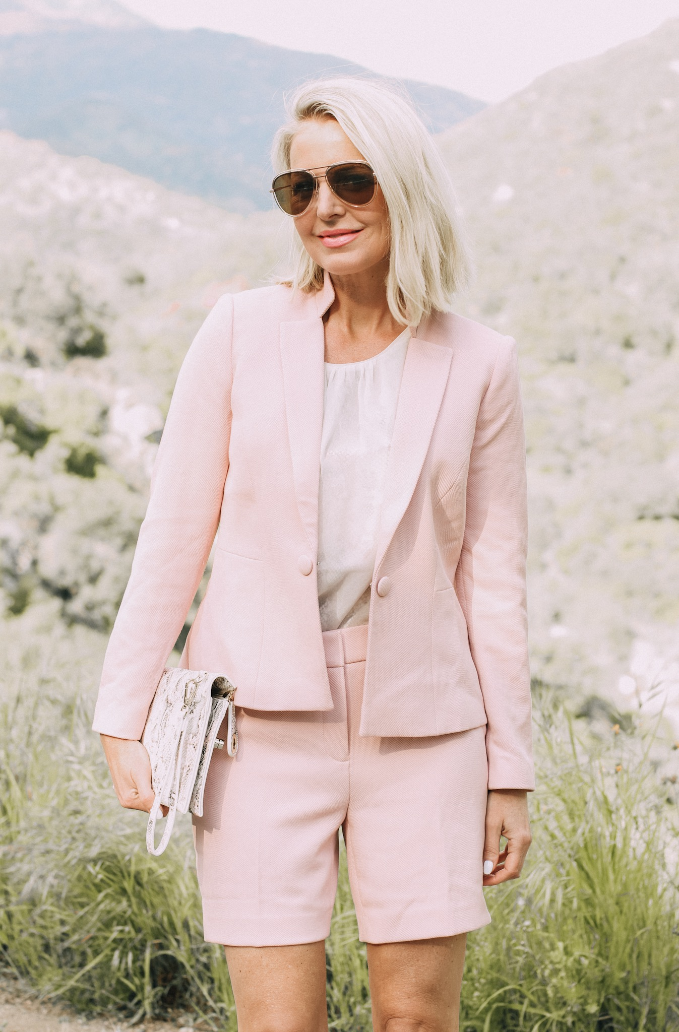 Spring Office Outfits, Fashion blogger Erin Busbee of BusbeeStyle.com wearing matching pink shorts and blazer with pink snake print heels and clutch from White House Black Market in Sequoia National Park