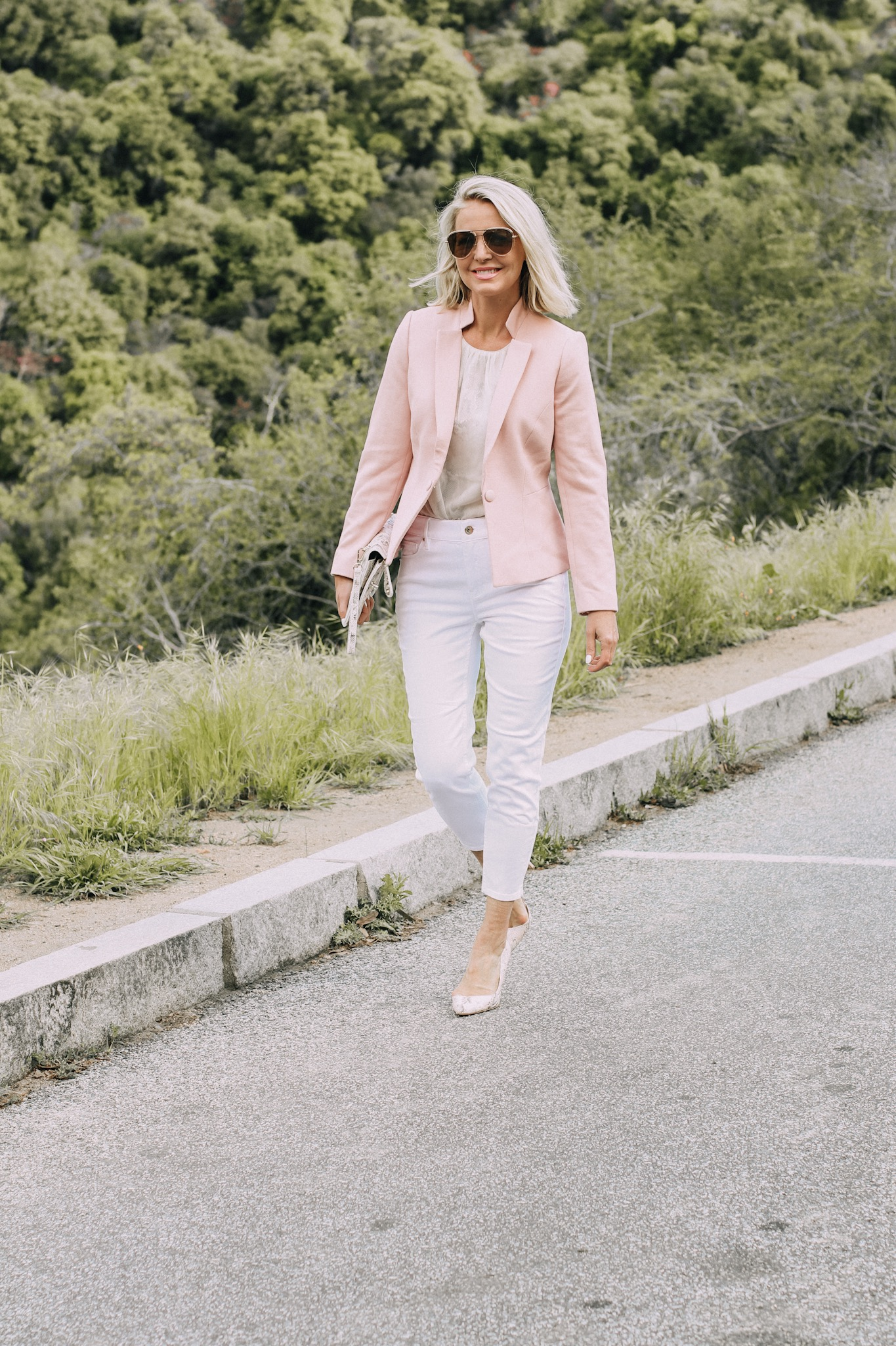 Spring Office Outfits, Fashion blogger Erin Busbee of BusbeeStyle.com wearing a blazer with a snake print shell and white cropped jeans, with pink snake print heels and clutch from White House Black Market in Sequoia National Park