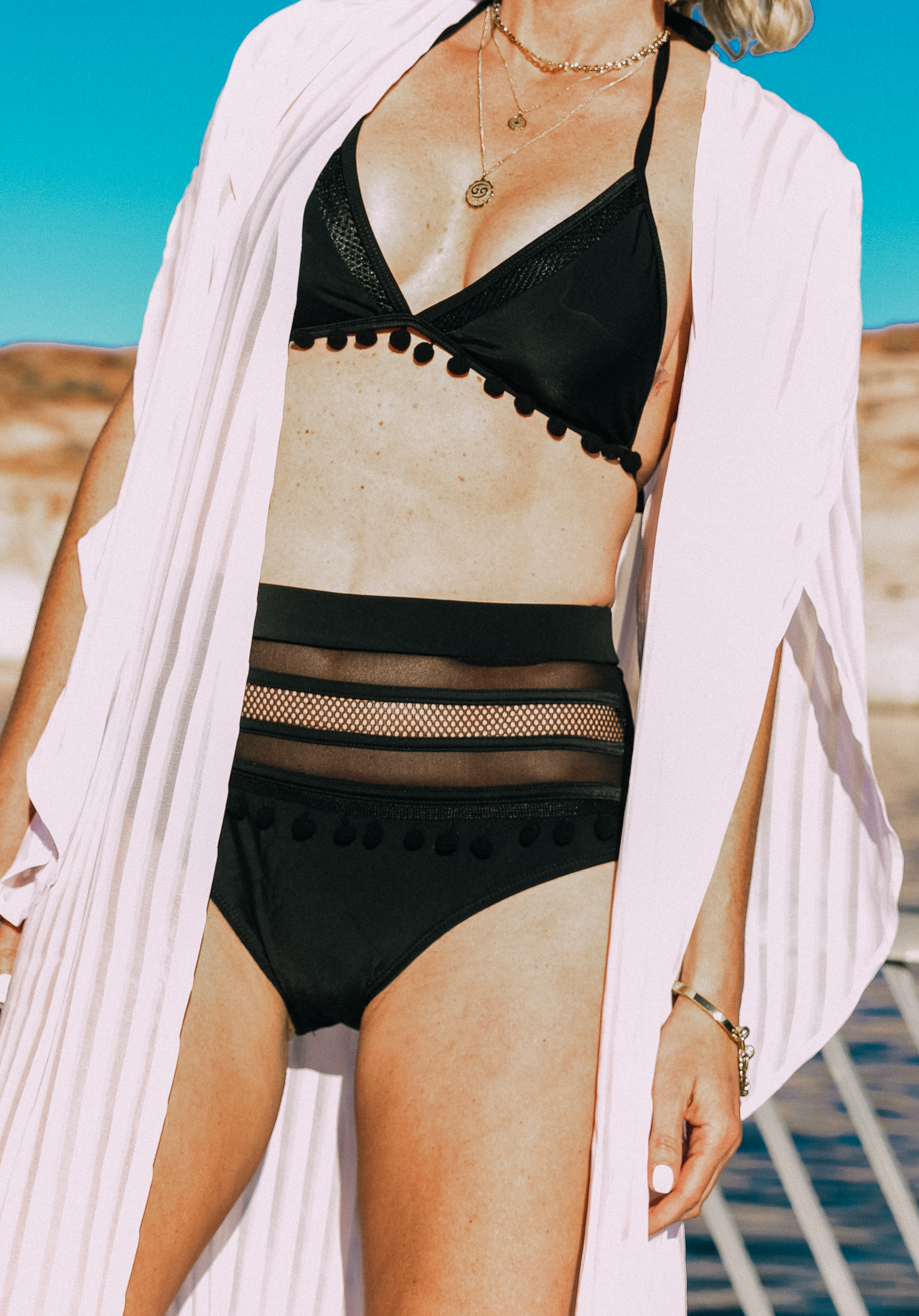 Amazon Find, Fashion blogger Erin Busbee of Busbee Style wearing a black pom pom and mesh high waist bikini from Amazon at Lake Powell with a white coverup and Treasure and Bond wedges