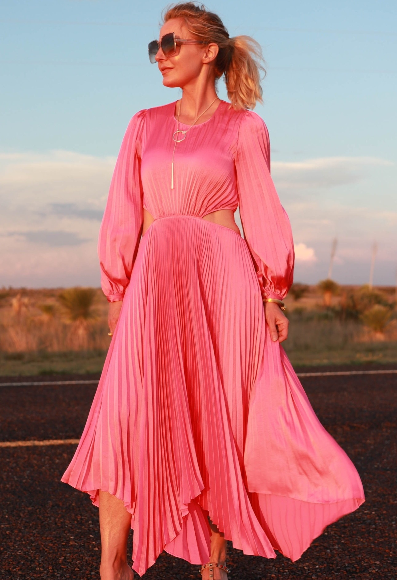 ALC pink pleated dress midi length with cutouts and sleeves on fashion over 40 blogger Erin Busbee