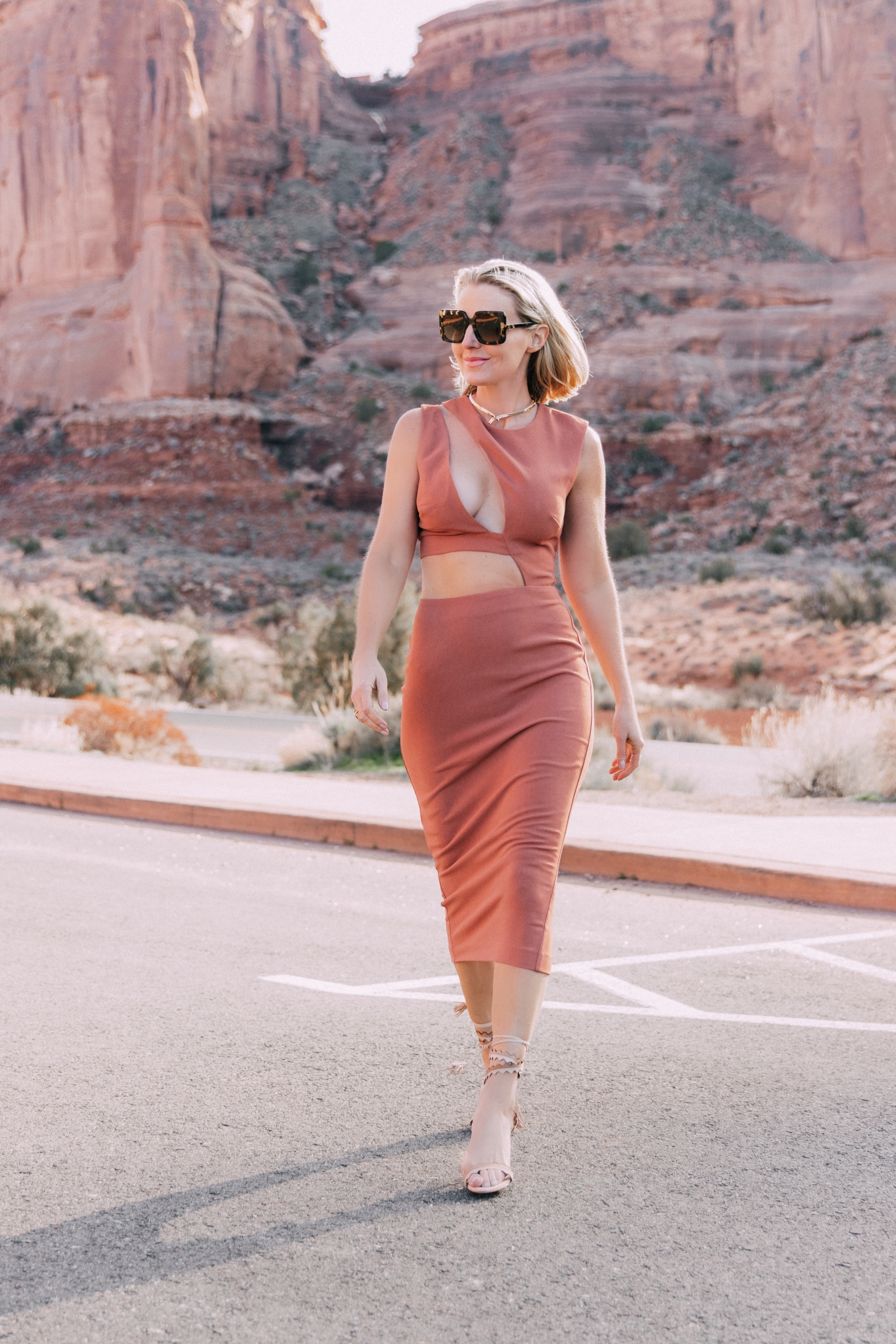 Trendy Rust Colored Midi Dress with Sexy Cutouts on fashion over 40 blogger Erin Busbee in Moab, Utah #3