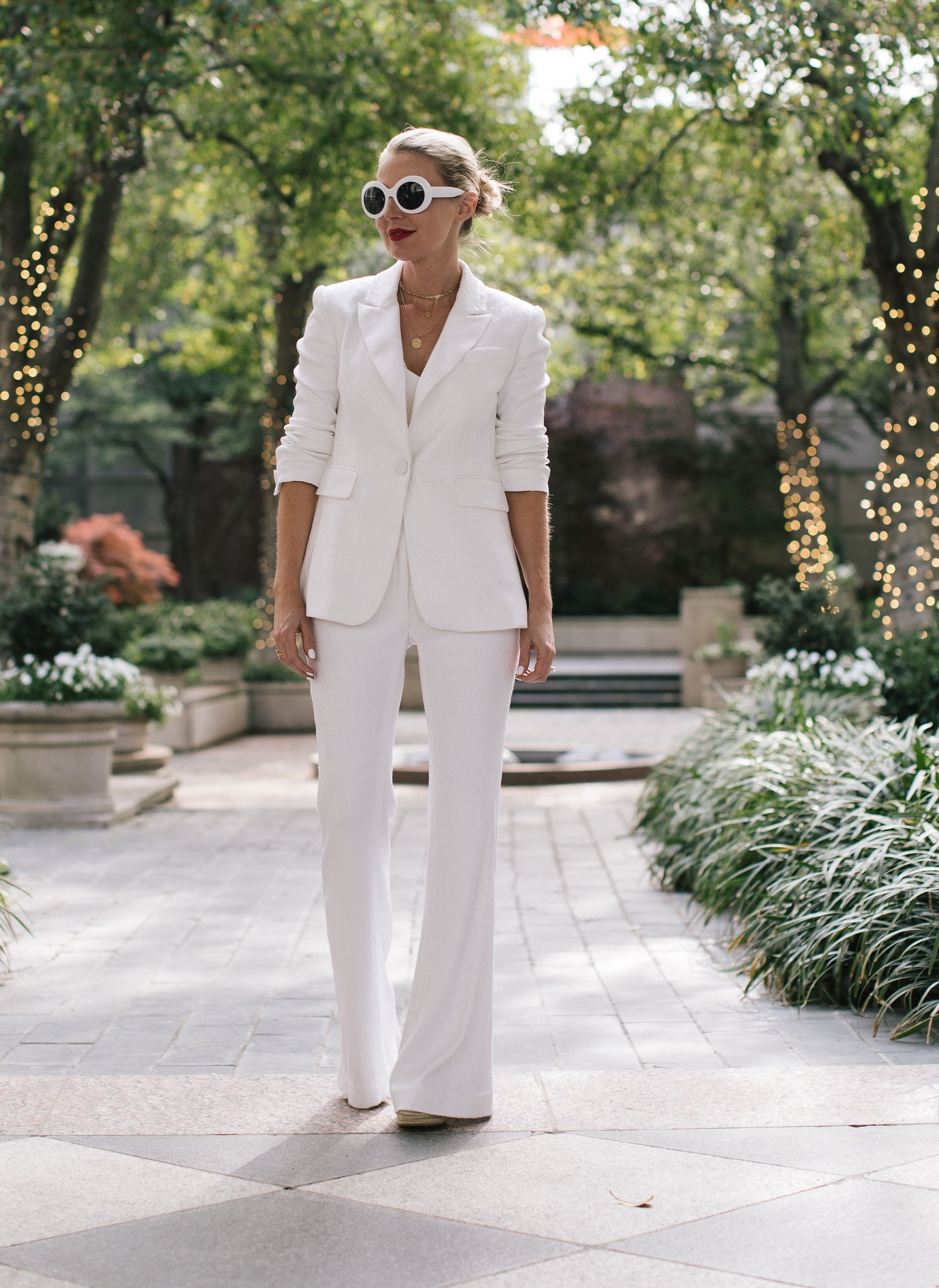 Perfect White Suit, Fashion blogger Erin Busbee of BusbeeStyle.com wearing a matching white sequin blazer and wide leg pants by Rachel Zoe, white pointed toe pumps, and a white chloe nile bag in Dallas, Texas