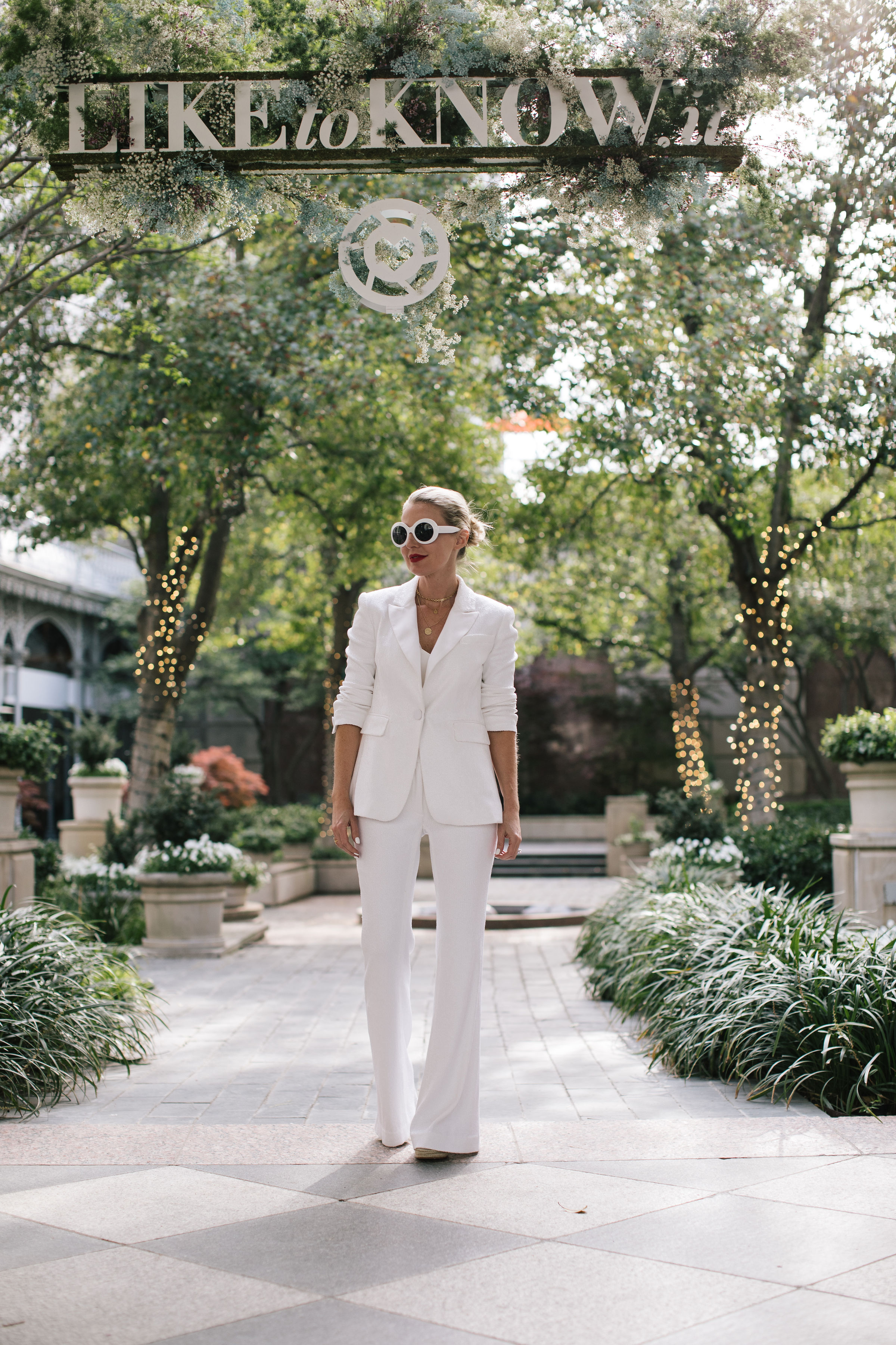 Perfect White Suit, Fashion blogger Erin Busbee of BusbeeStyle.com wearing a matching white sequin blazer and wide leg pants by Rachel Zoe, white pointed toe pumps, and a white chloe nile bag in Dallas, Texas, white monochromatic outfits