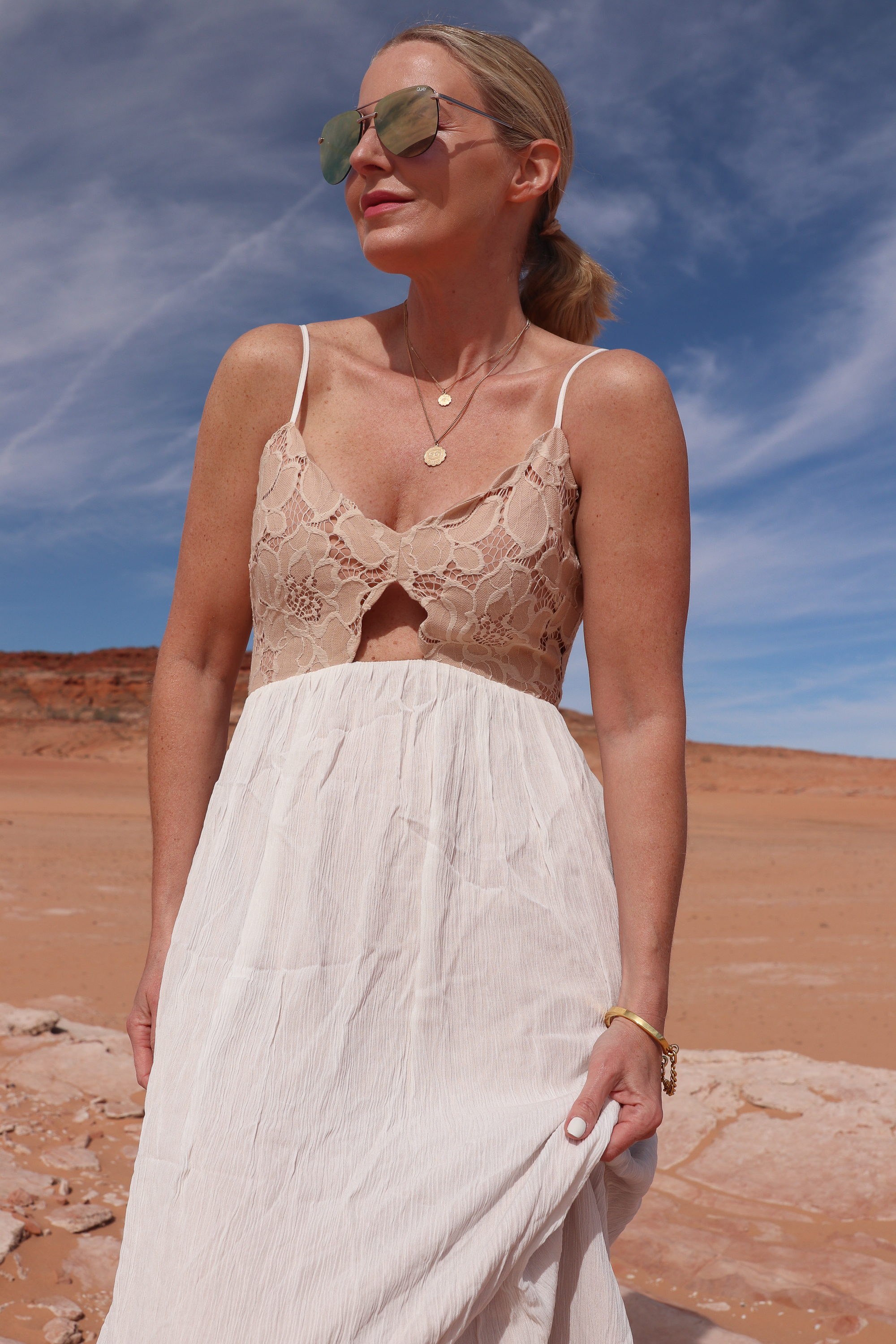 fashion blogger wearing tularosa maxi dress with aviator sunglasses and gold necklaces