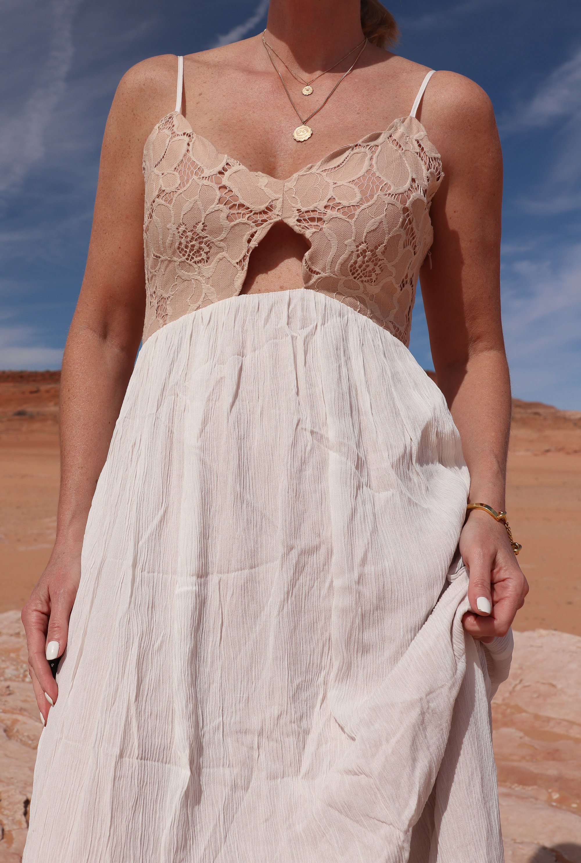 lace tularosa maxi dress worn by fashion blogger with gold necklaces
