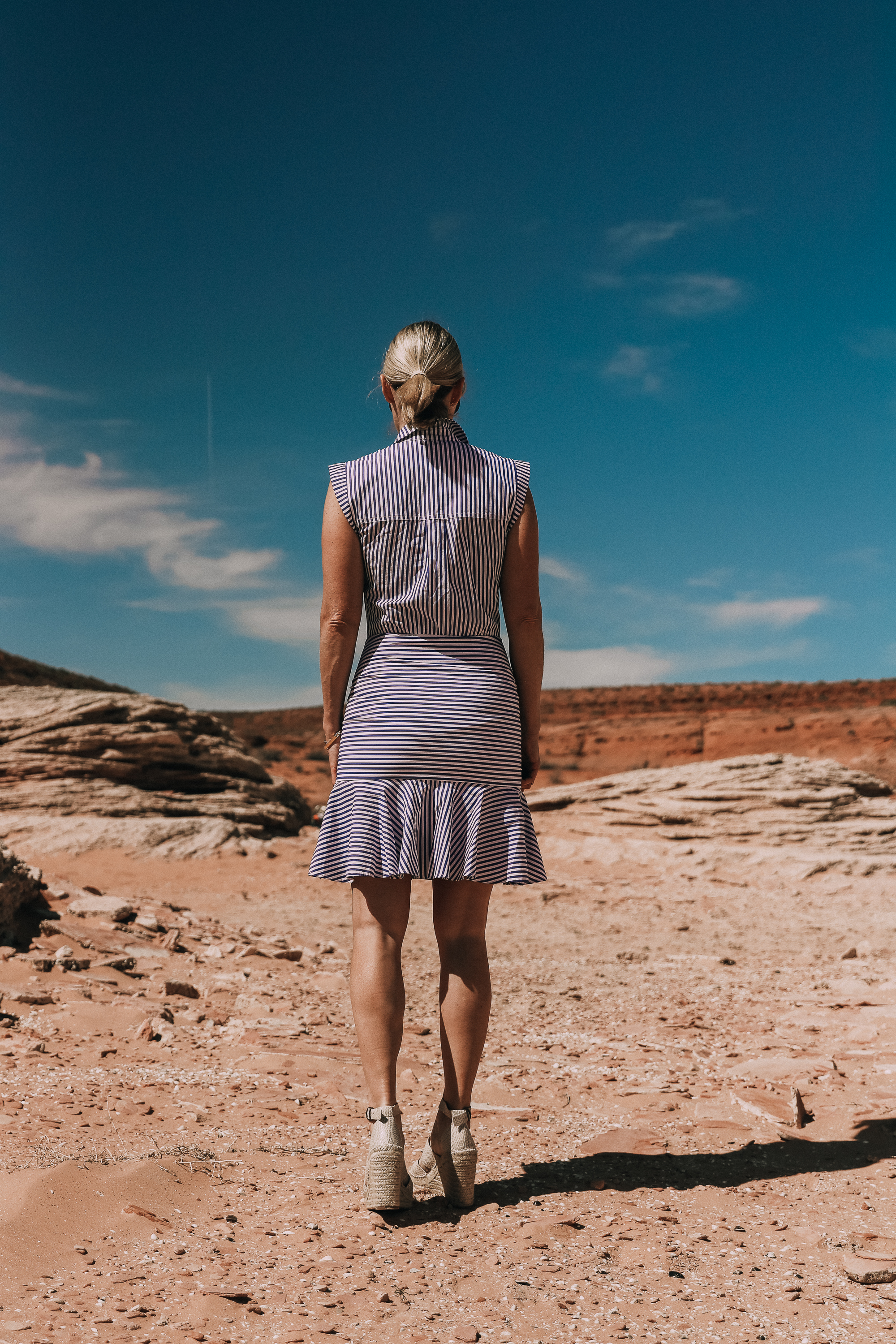 back of veronica beard bell button down blue and white striped dress work by fashion blogger in lake powell