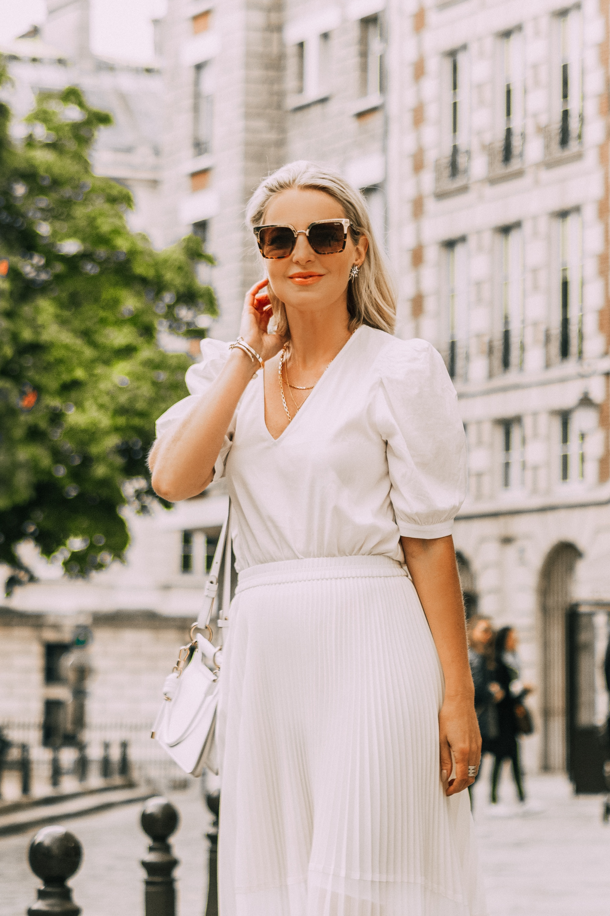 Perfect Midi Skirt, Fashion blogger Erin Busbee of BusbeeStyle.com wearing a white midi skirt from Club Monaco with a white bodysuit, See by Chloe espadrille wedges, and a white Givenchy bag in Paris, France