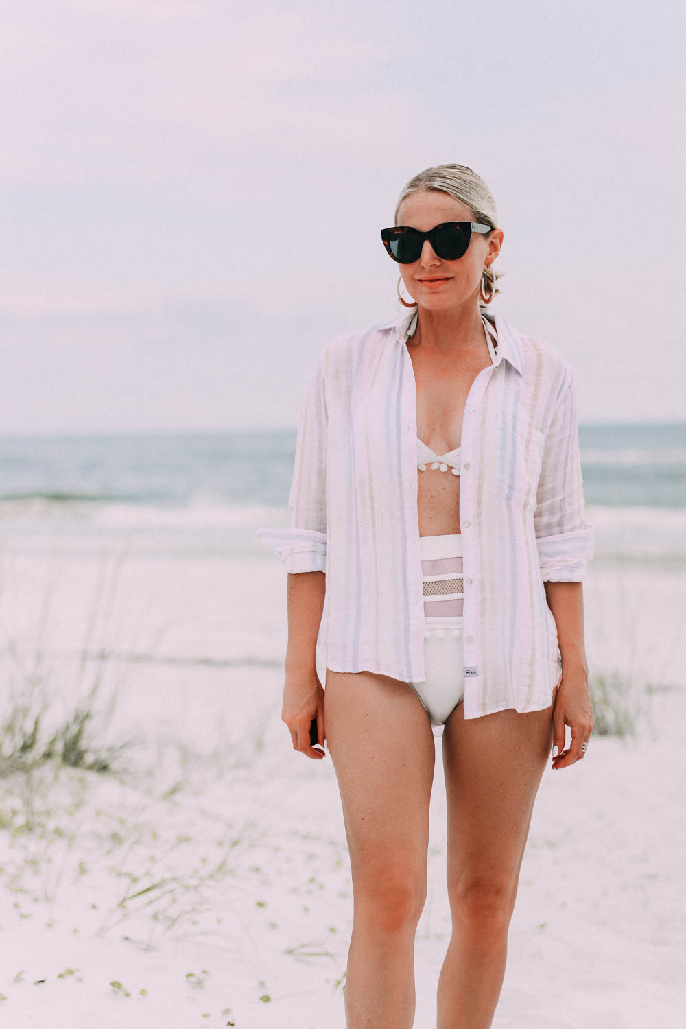 Amazon swimsuit, Fashion blogger Busbee Style wearing white bikini with pom poms from Amazon with striped Rails button down shirt on Florida beach