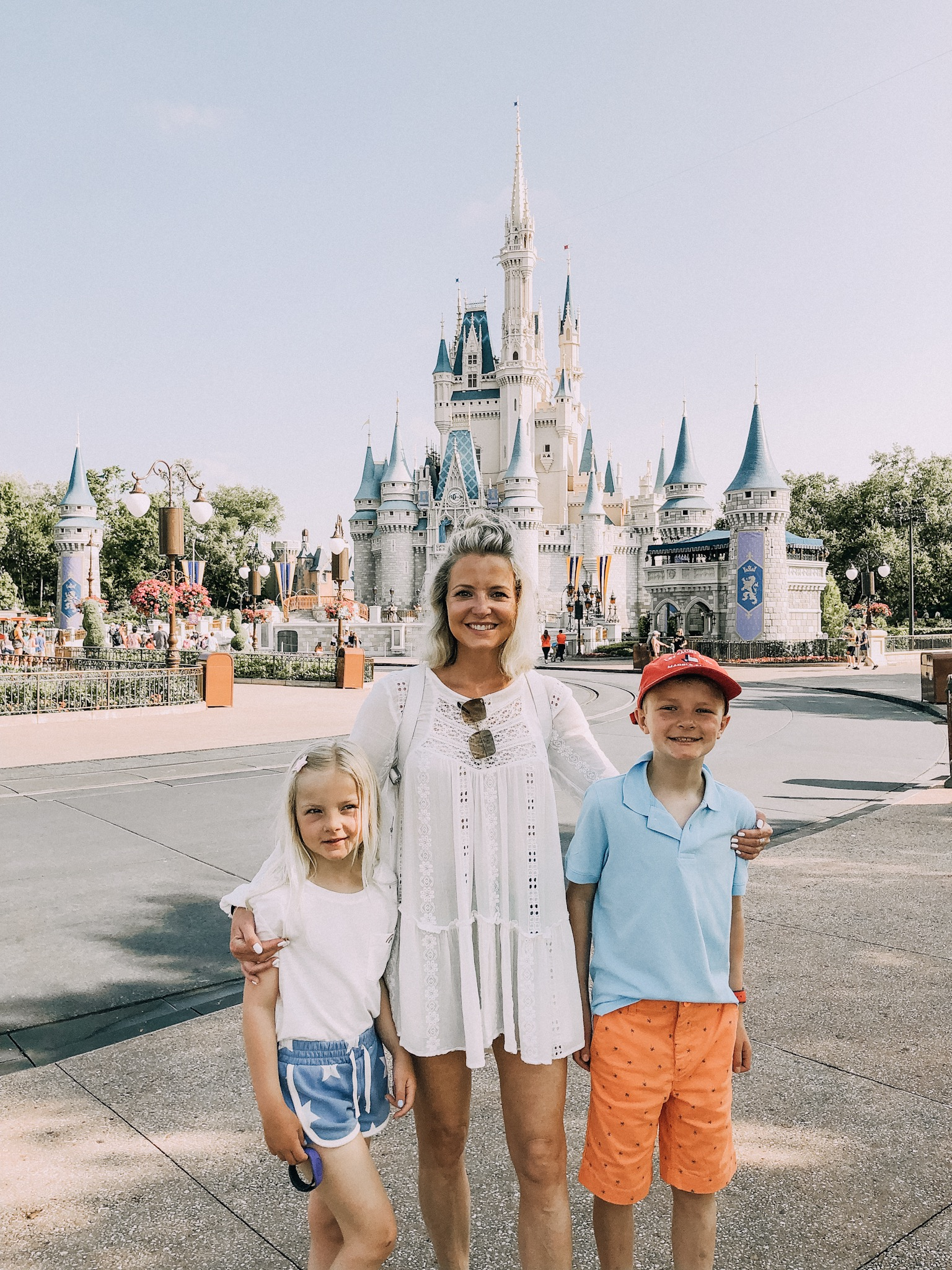 What I Wore At Disney, Fashion blogger Erin Busbee of BusbeeStyle.com wearing a Free People tunic top and denim shorts at Walt Disney World