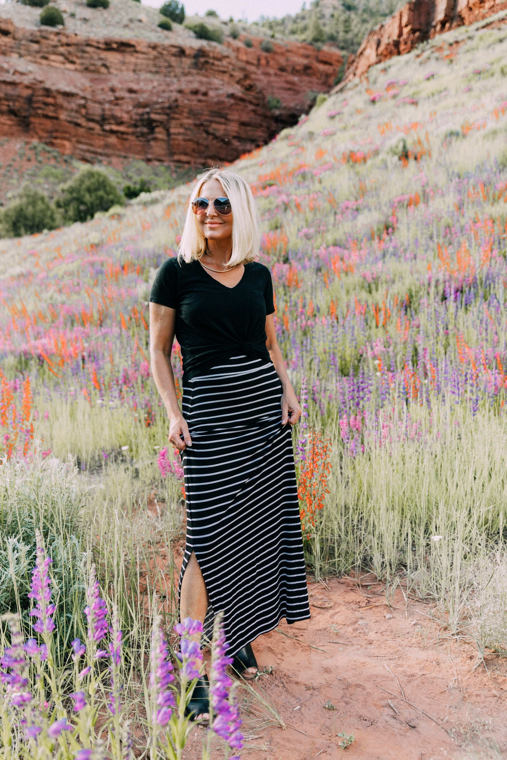Ways To Wear Stripes, Fashion blogger Erin Busbee wearing a striped maxi skirt, black v-neck tee, and black peep toe mules from JCPenney in the wildflowers in Telluride, CO