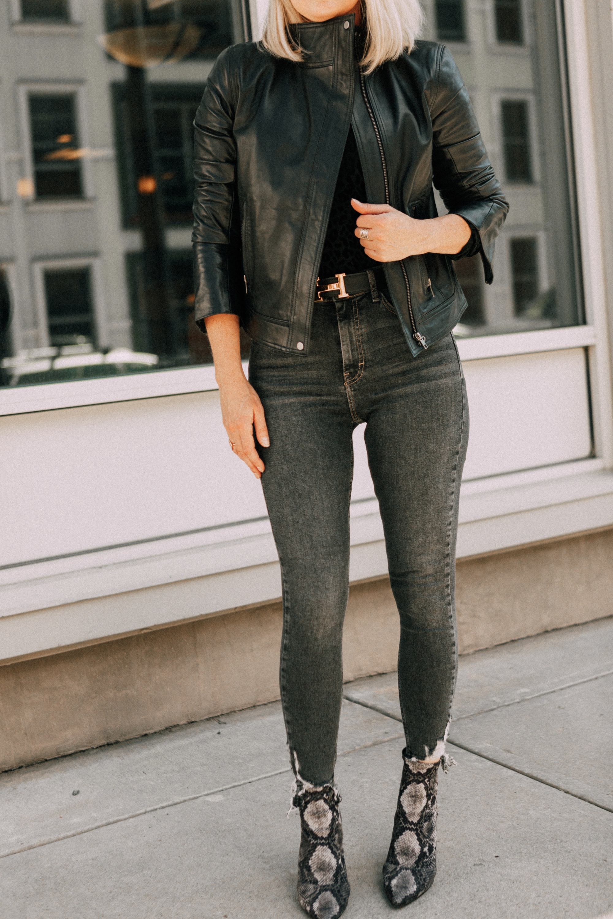 Leather Moto Jacket, Fashion blogger over 40 Erin Busbee of BusbeeStyle.com featuring the Chelsea28 black leather jacket from the Nordstrom Anniversary Sale 2019 styled with the velvet leopard bodysuit, Topshop jeans, and Charles Davidson python print booties from Nordstrom in Telluride, Colorado