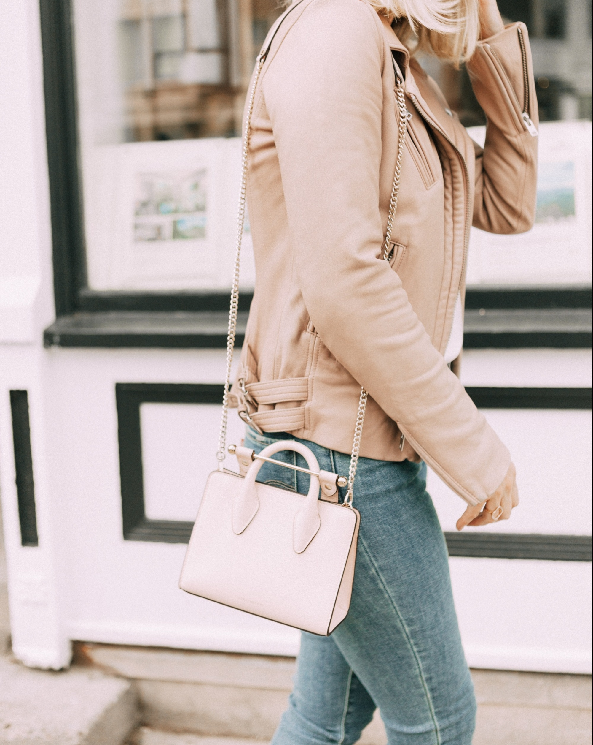 Hot Handbags, Fashion blogger Erin Busbee of BusbeeStyle.com wearing a pale pink Strathberry Nano Tote with a beige leather jacket by IRO, white lace cami, and Levi jeans in Telluride, Colorado