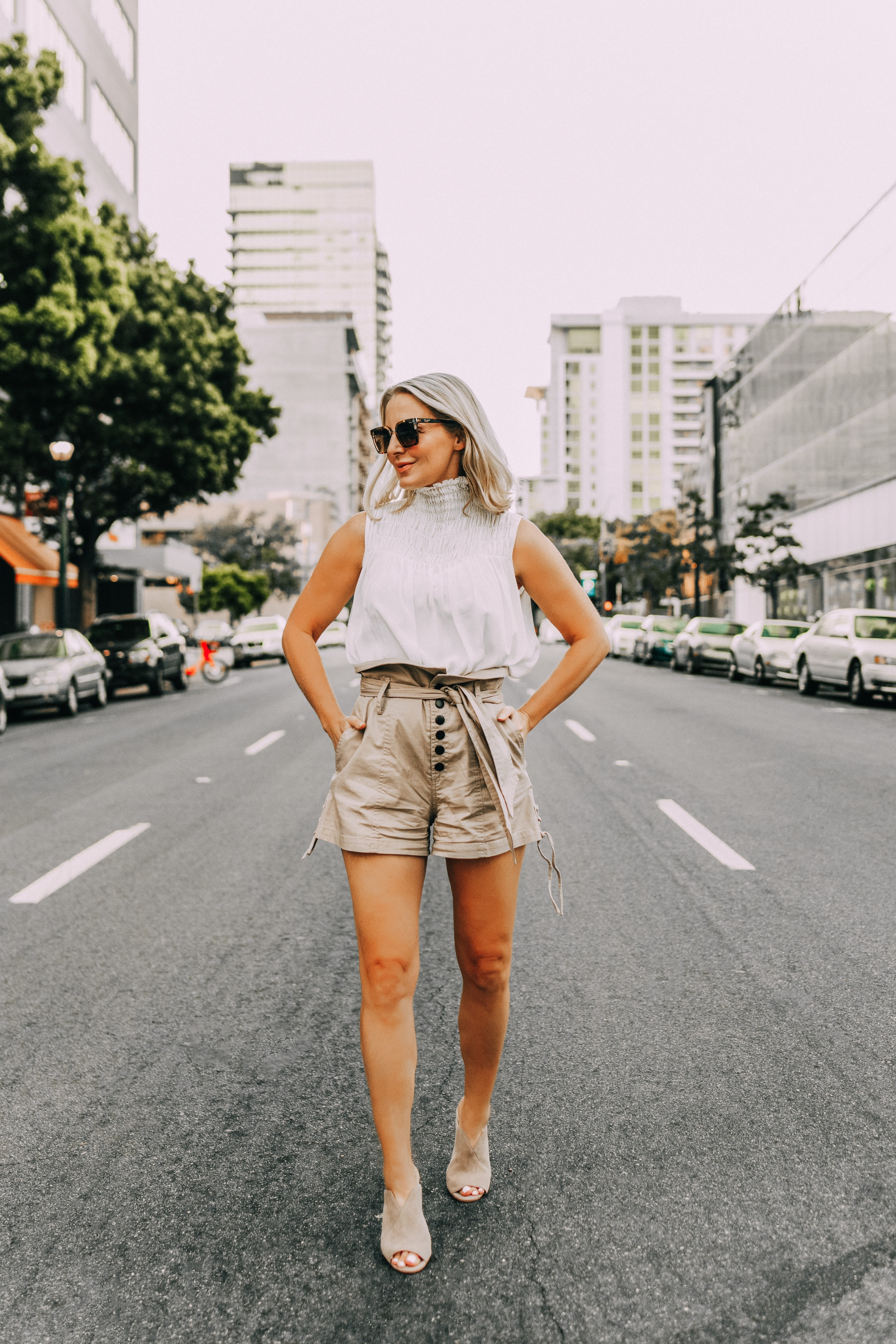 Paper bag shorts, fashion blogger Erin Busbee of BusbeeStyle.com wearing paper bag shorts by Marissa Webb with a white Frame sleeveless high neck top and Vince Camuto peep toe mules in San Diego, CA
