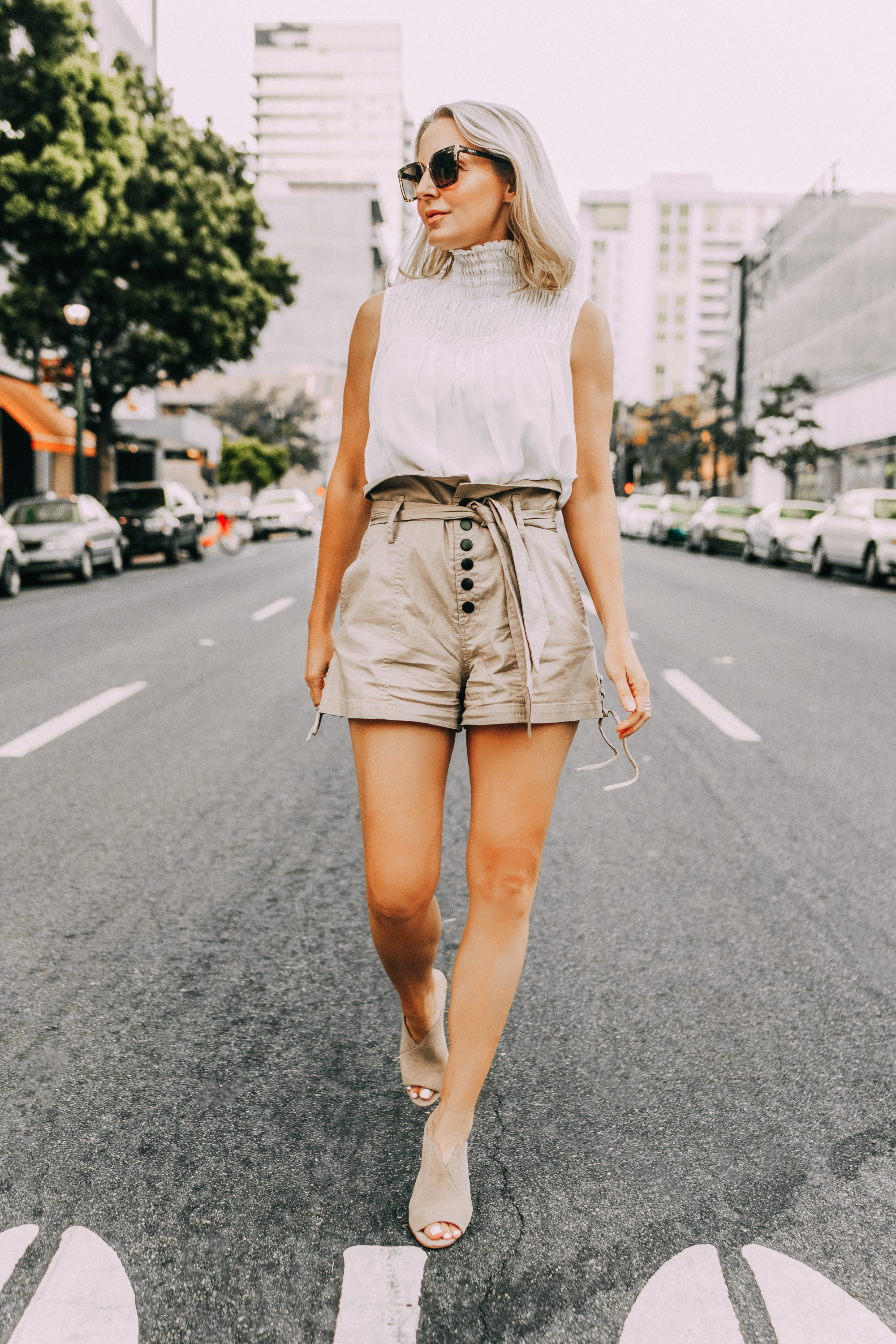 Paper bag shorts, fashion blogger Erin Busbee of BusbeeStyle.com wearing paper bag shorts by Marissa Webb with a white Frame sleeveless high neck top and Vince Camuto peep toe mules in San Diego, CA, brands helping with covid19