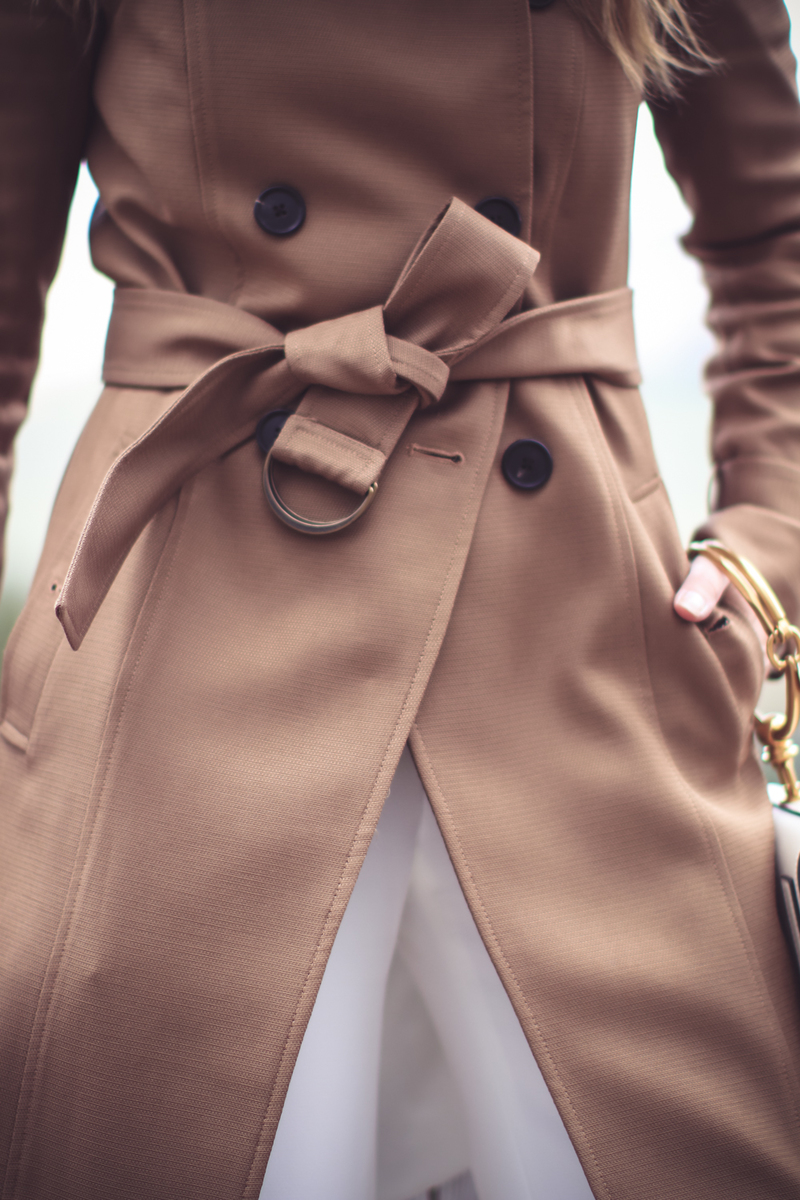 trench belted at waist closet up image