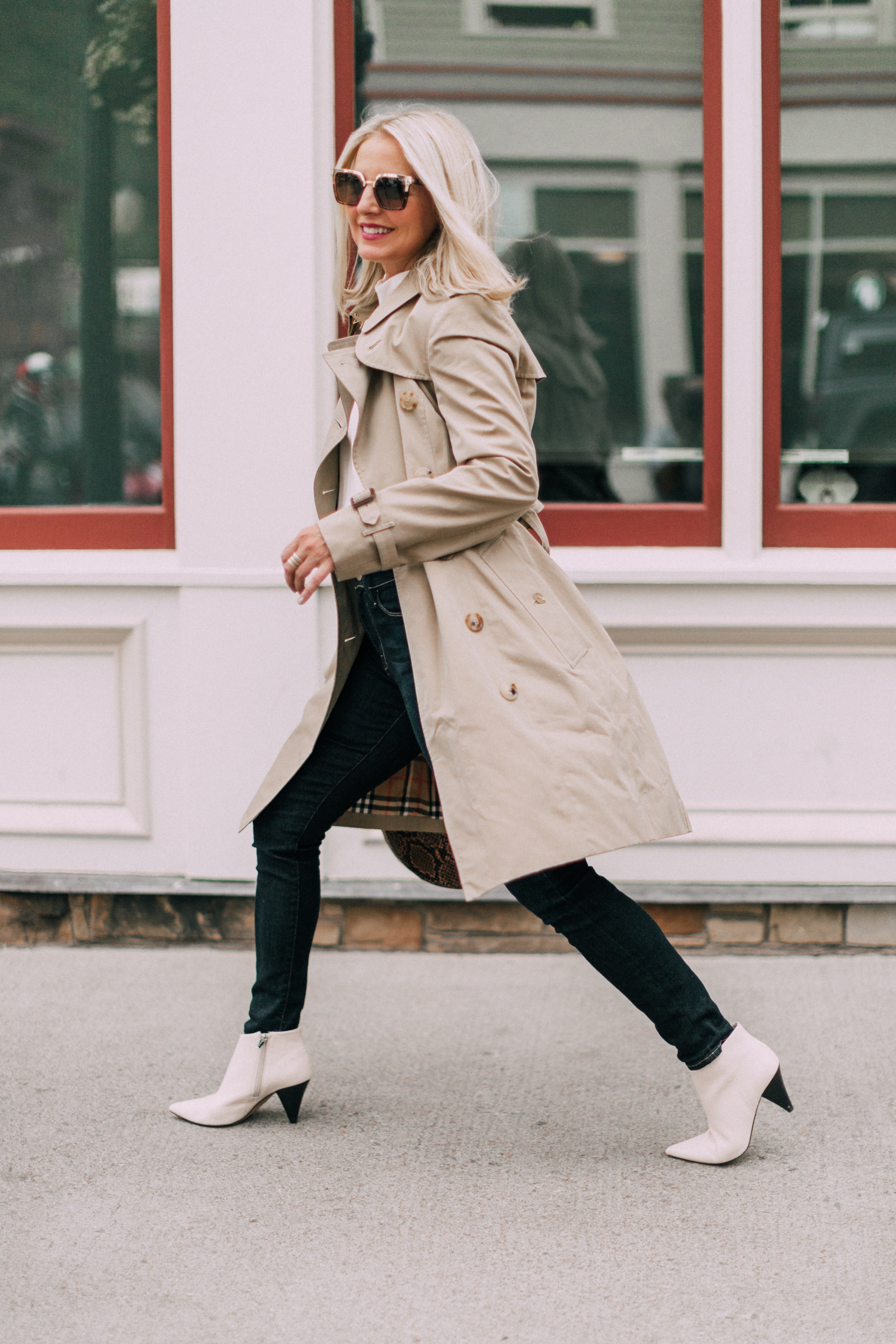 Burberry Chelsea Slim Fit Heritage dark honey trench coat with blue jeans white booties