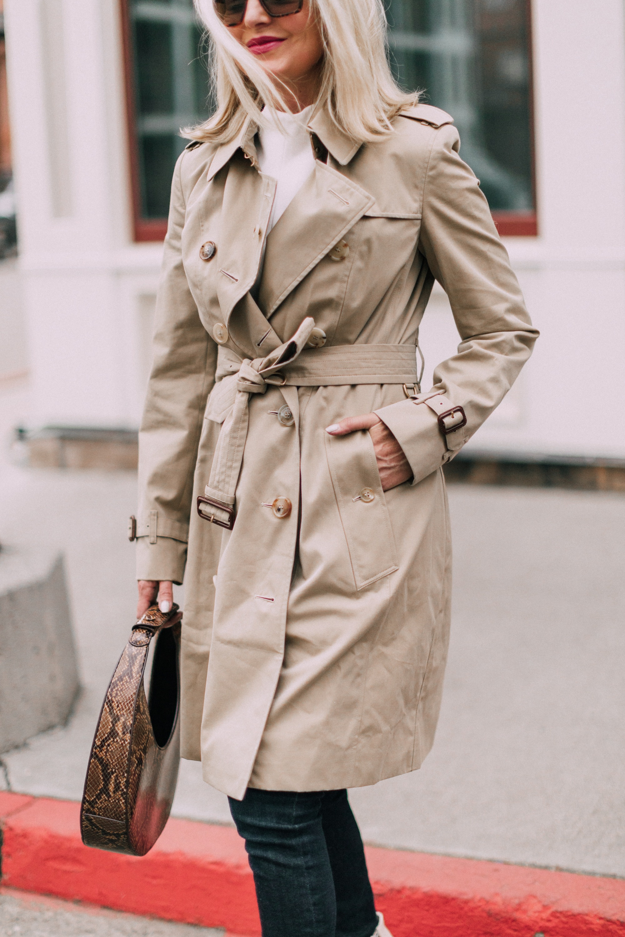 Burberry Chelsea Slim Fit Heritage trench coat with blue jeans staud moon bag outfit