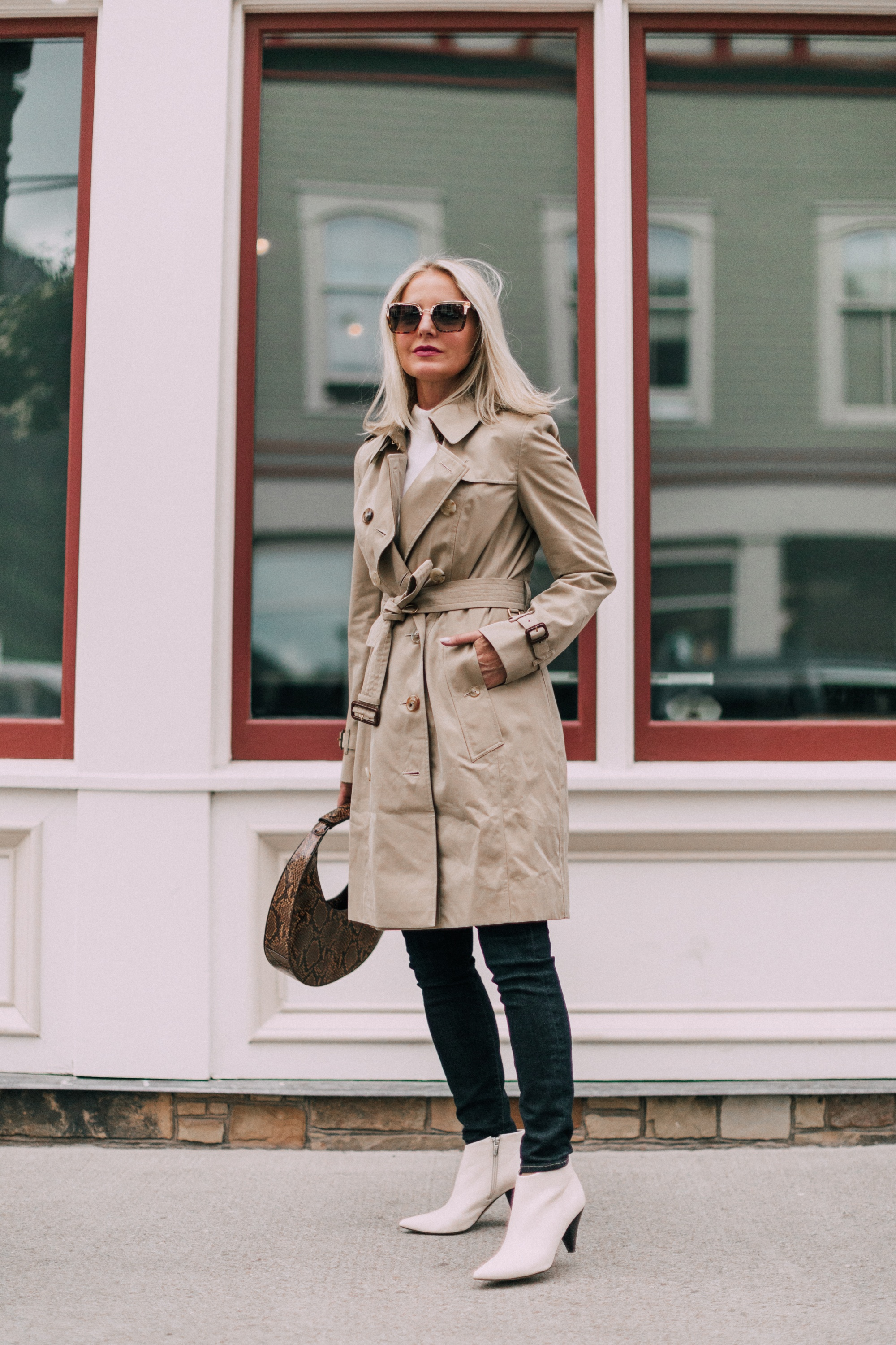 Burberry Chelsea Slim Fit Heritage dark honey trench coat with white booties blue jeans outfit