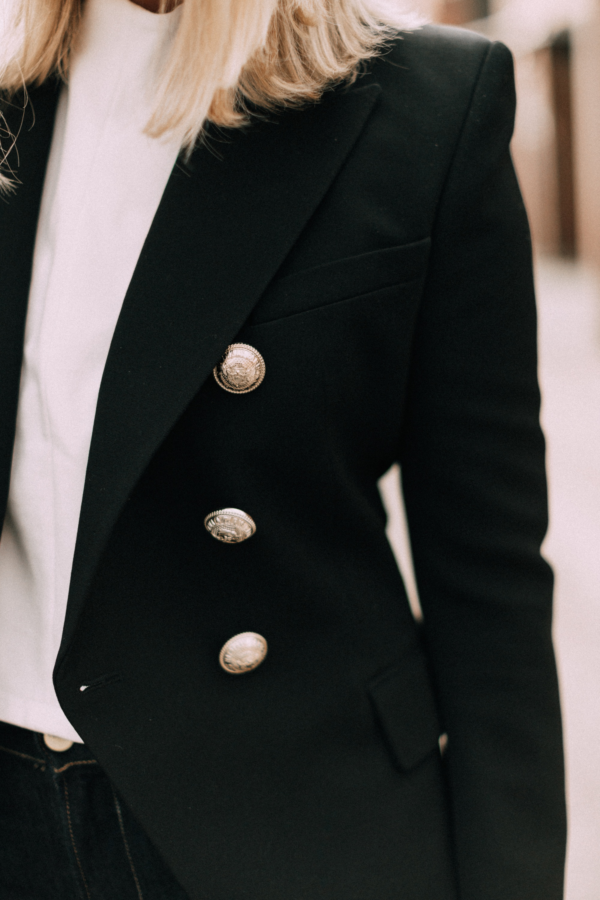 black Balmain blazer with gold buttons outfit worn with white top