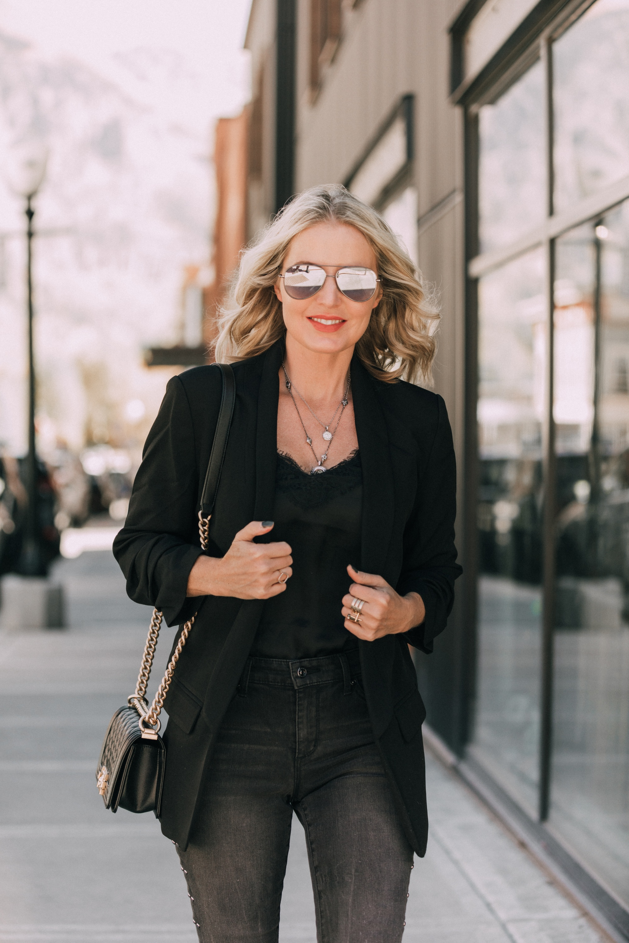 Boyfriend Blazer, Fashion blogger Erin Busbee of BusbeeStyle.com wearing a black boyfriend blazer and black studded jeans Scoop with a black cami and black bag from Walmart in Telluride, CO