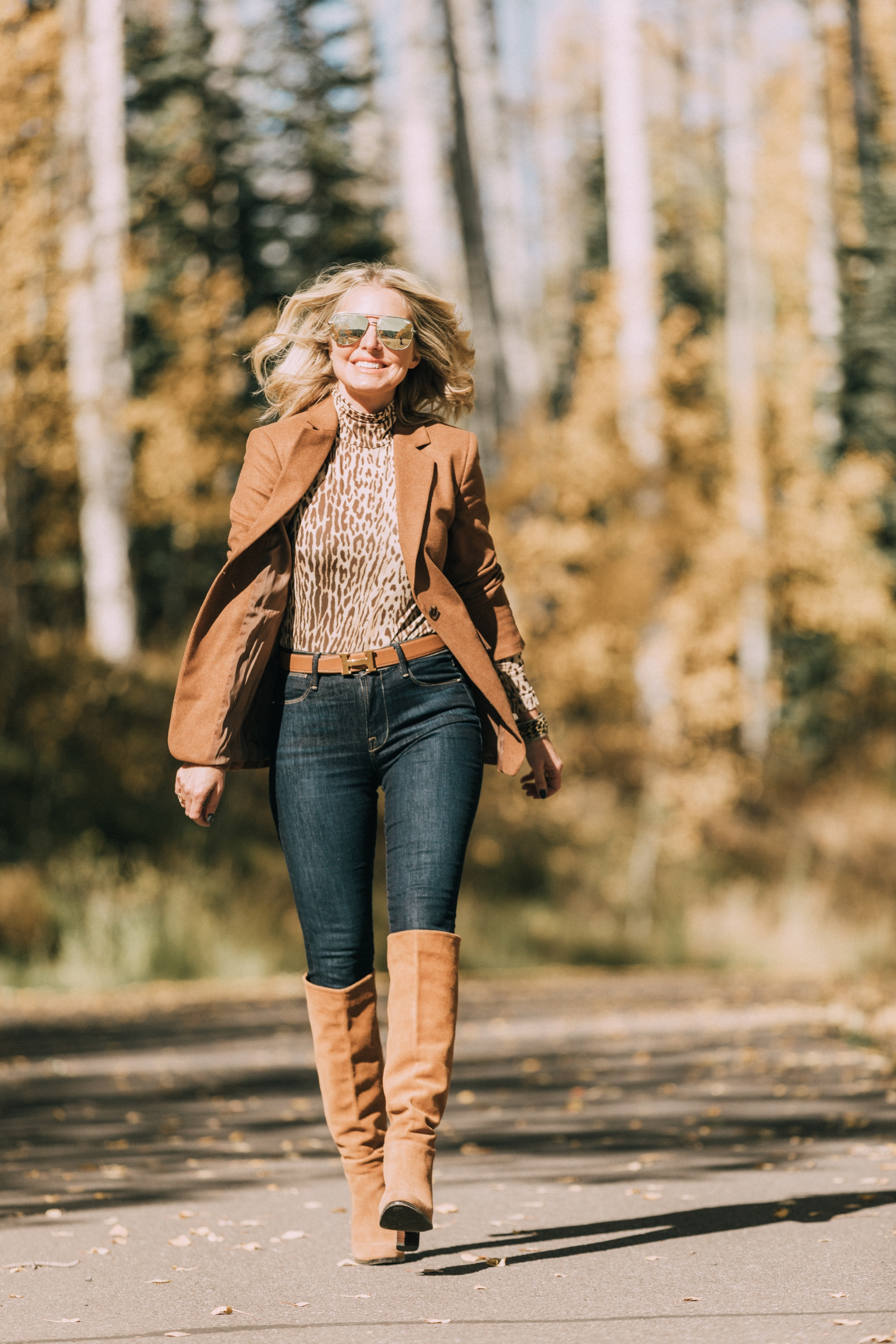fashion blogger erin busbee wearing camel brown blazer over zimmerman leopard print turtleneck skinny jeans paired with sam edelman knee high suede boots