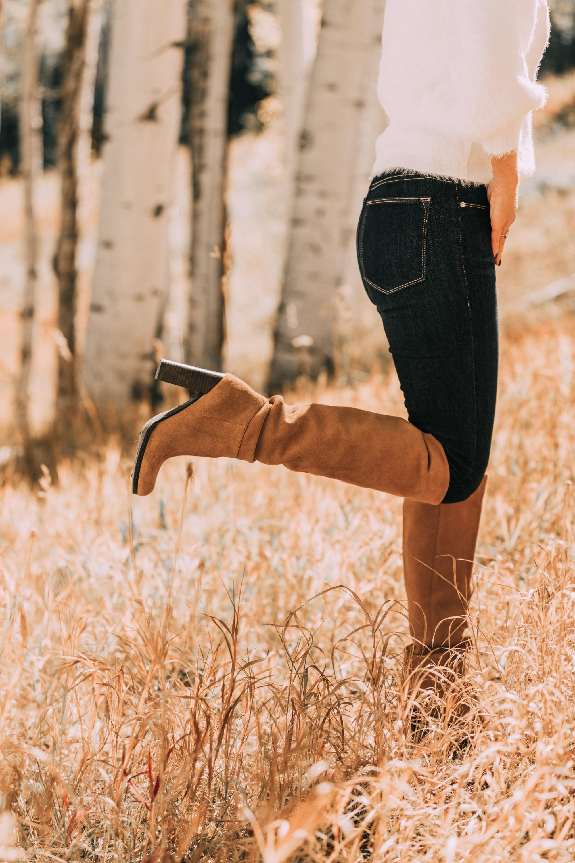 brown suede knee high boots worn with rag & bone skinny blue jeans white fuzzy line & dot sweater