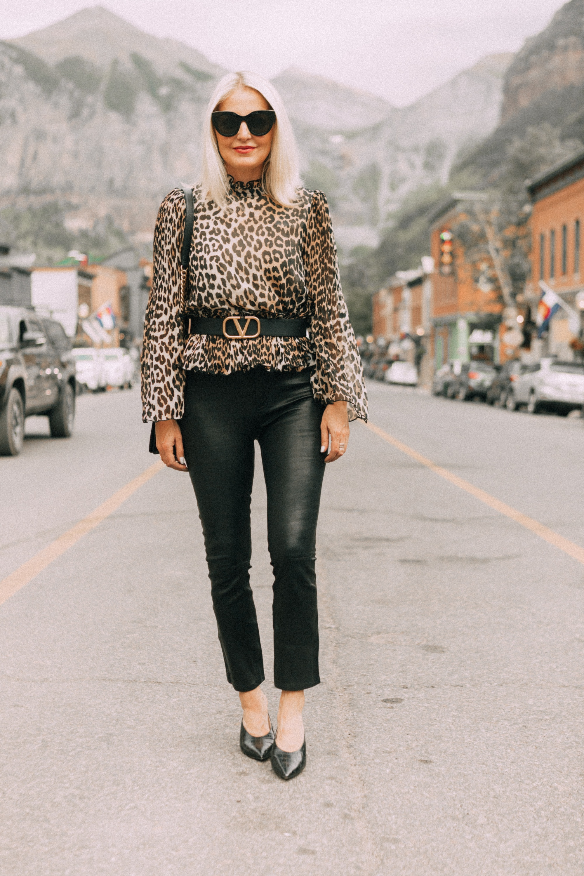 high neck blouse in leopard print by Ganni on fashion blogger erin busbee in Telluride colorado