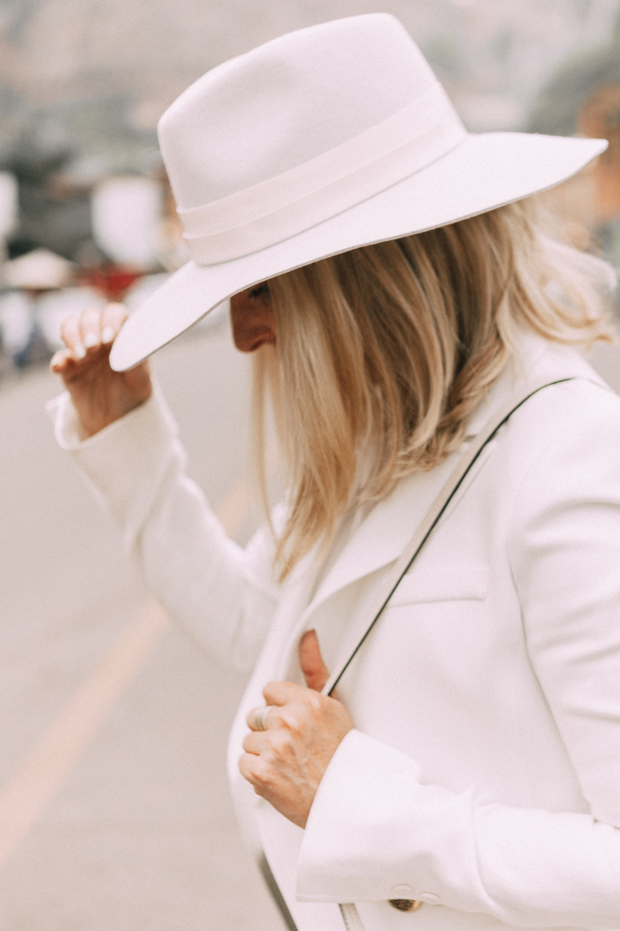 How To Wear Hats, Fashion blogger Erin Busbee of BusbeeStyle.com wearing a Janessa Leone white fedora with white Lioness blazer, white Tibi top, skinny jeans, white Chloe Nile bag, and white booties in Telluride, CO