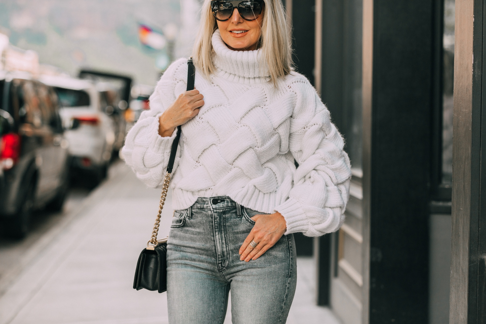 How To Style Dad Sneakers, Fashion blogger Erin Busbee of BusbeeStyle.com wearing designer dad sneakers with Mother ankle zip jeans, Lovers + Friends white sweater, and Chanel Boy Bag in Telluride, CO