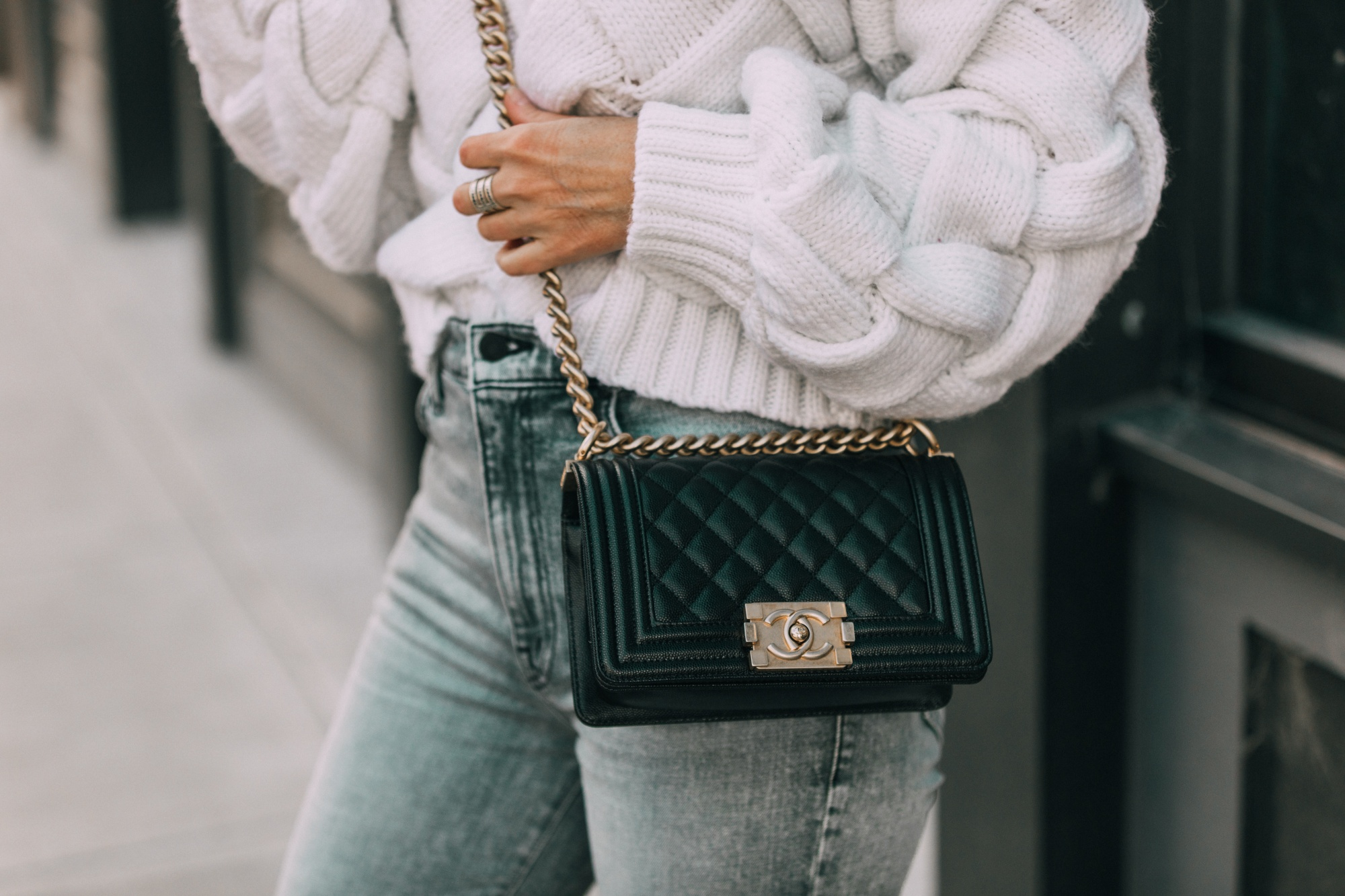 Designer Handbags For Fall, Fashion blogger Erin Busbee of BusbeeStyle.com carrying the Chanel boy bag wearing jeans and a sweater in Telluride, CO
