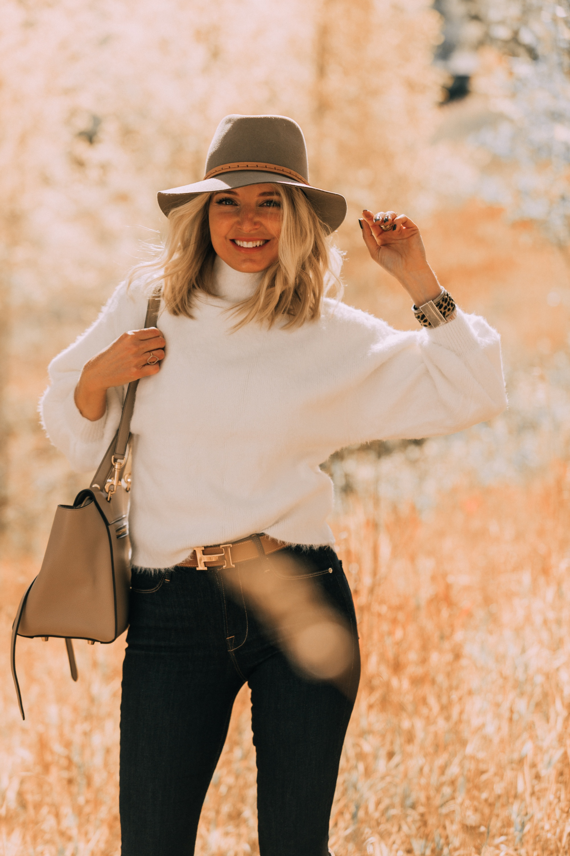 Fuzzy Sweaters, Fashion blogger Erin Busbee of BusbeeStyle.com wearing a white fuzzy sweater by Line & Dot with rag & bone skinny jeans, brown knee high boots, celine belt bag, and treasure & bond floppy brim hat in Telluride, Colorado