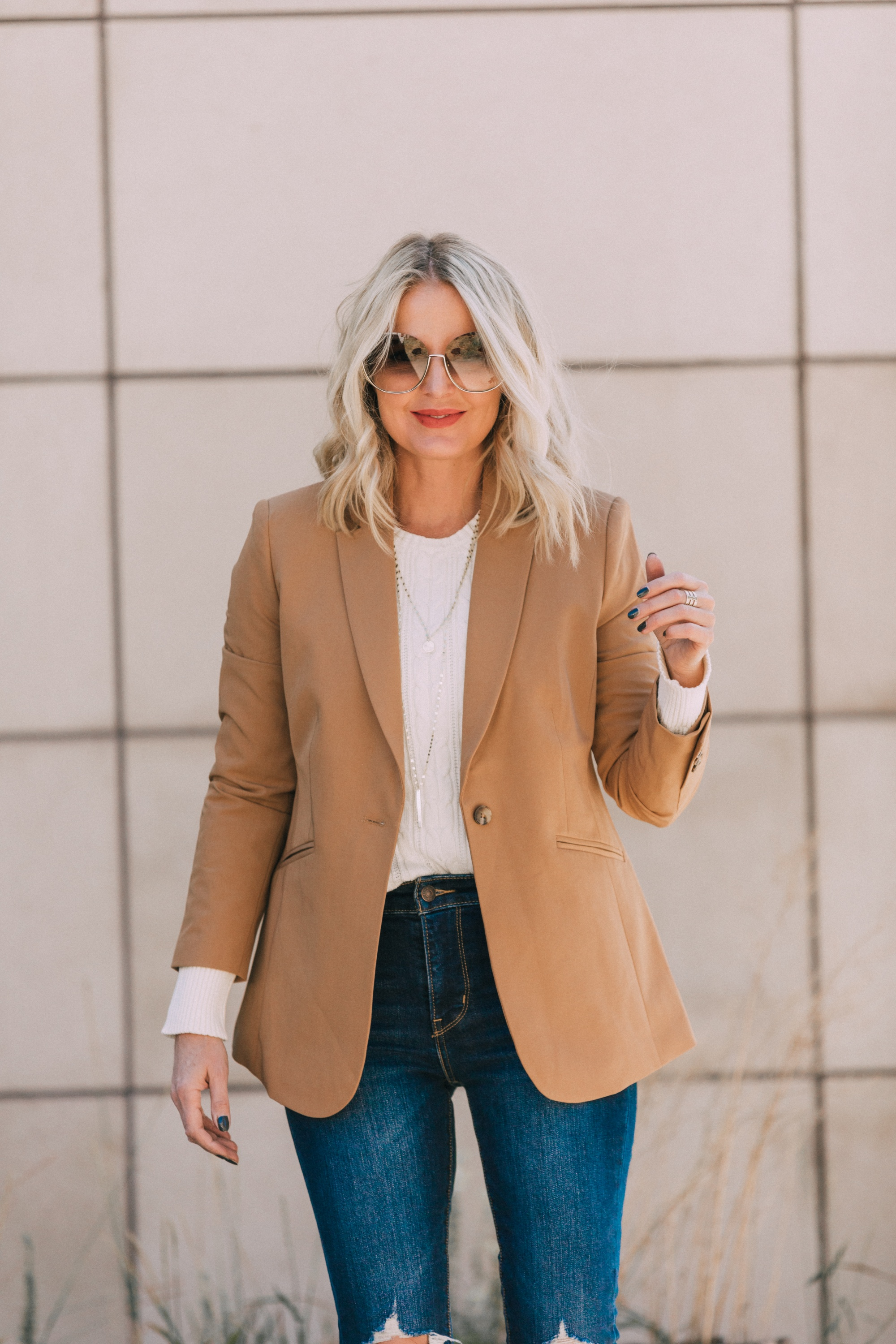 affordable camel colored blazer with blue jeans and white cable knit sweater outfit