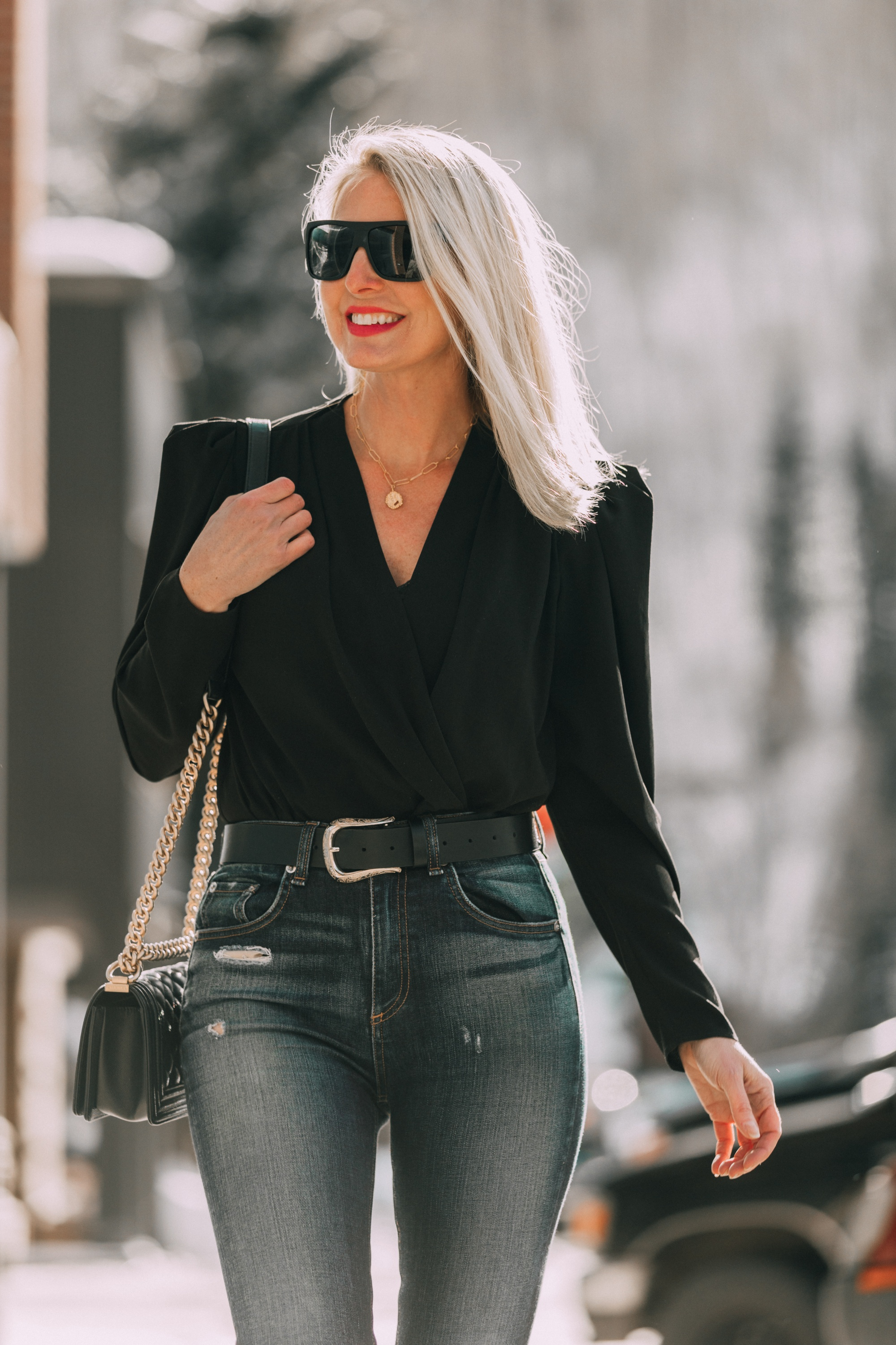 Women's fashion blogger, Erin Busbee shares 13 style hacks for women over 40 who love fashion. Here, she wears double sided fashion body tape.