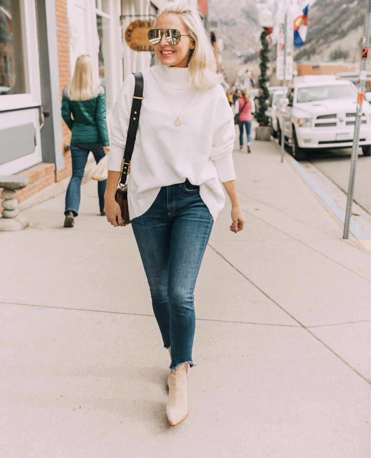 Women's fashion blogger, Erin Busbee, shares 5 fashion tips for women over 40 and wears a half tuck shirt