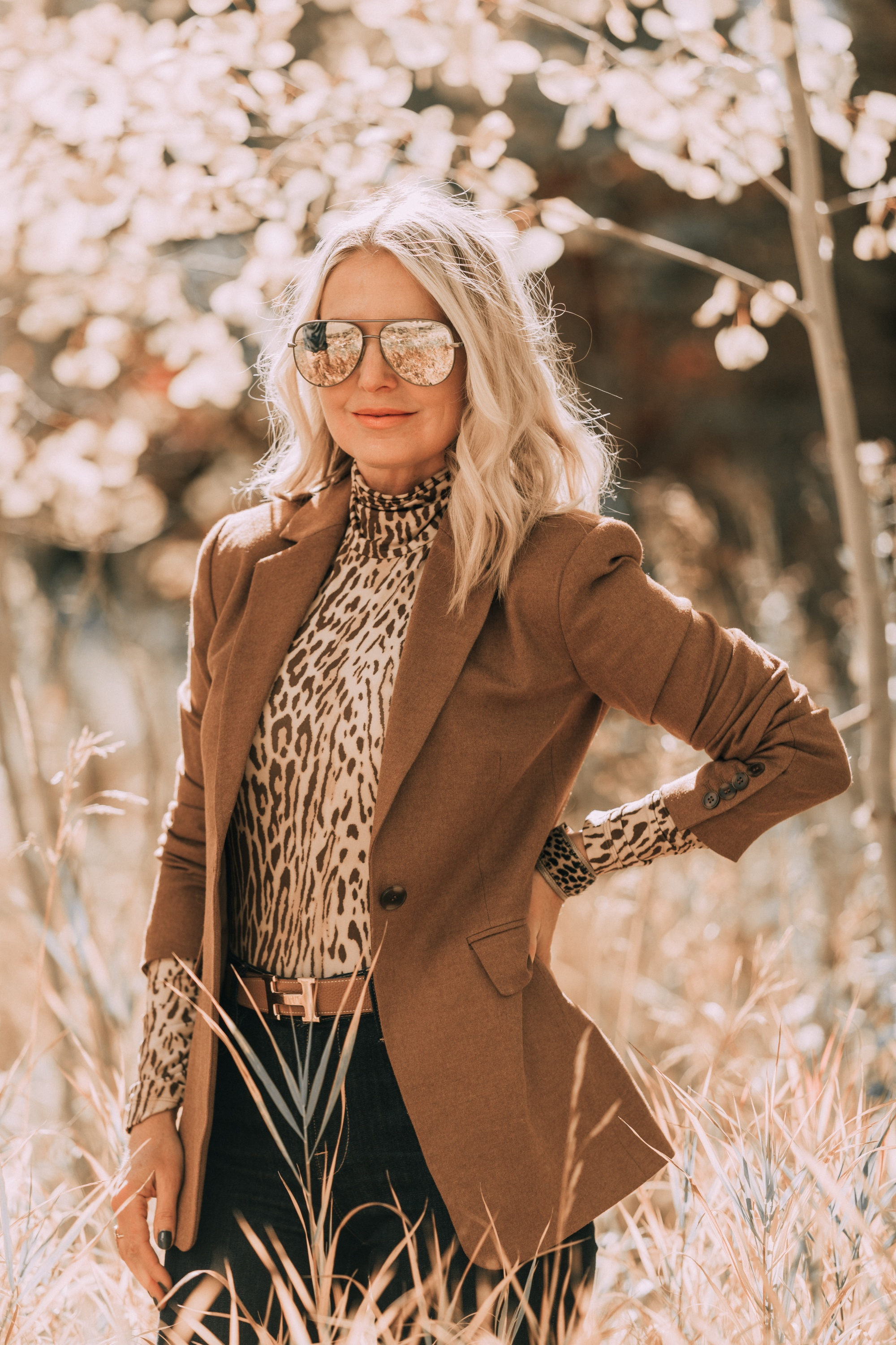 Neutral Fall Outfit, Fashion blogger Erin Busbee of BusbeeStyle.com wearing the camel brown Nordstrom signature blazer with a Zimmerman leopard print turtleneck, rag & bone skinny jeans, Sam Edelman knee high suede boots, and hermes belt in Telluride, CO