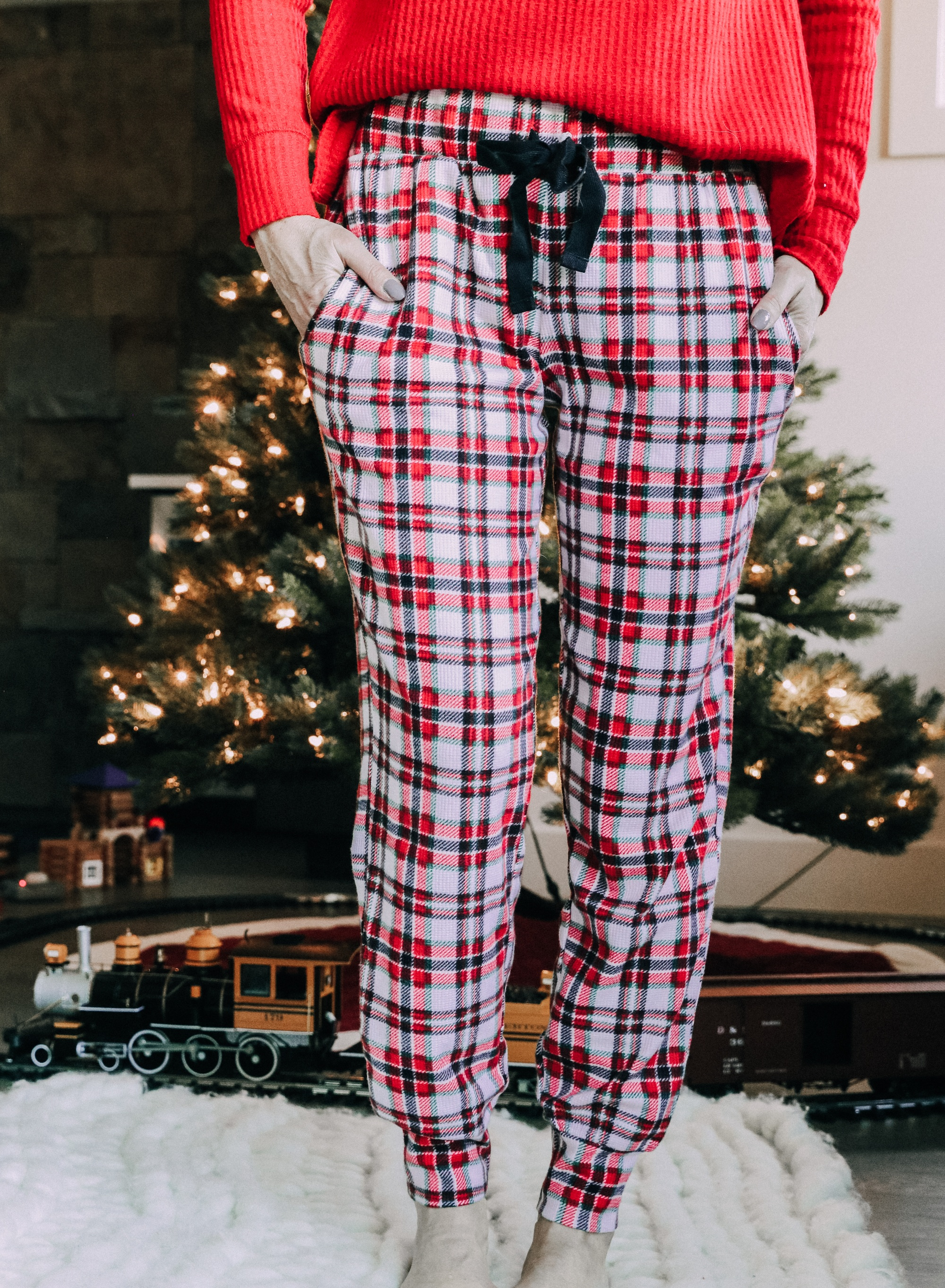 How to make holiday decorating easier, Fashion blogger Erin Busbee of BusbeeStyle.com sharing how to make the holidays more stress free wearing plaid pajamas and a red top by Jockey by her pre-lit tree in Telluride, CO